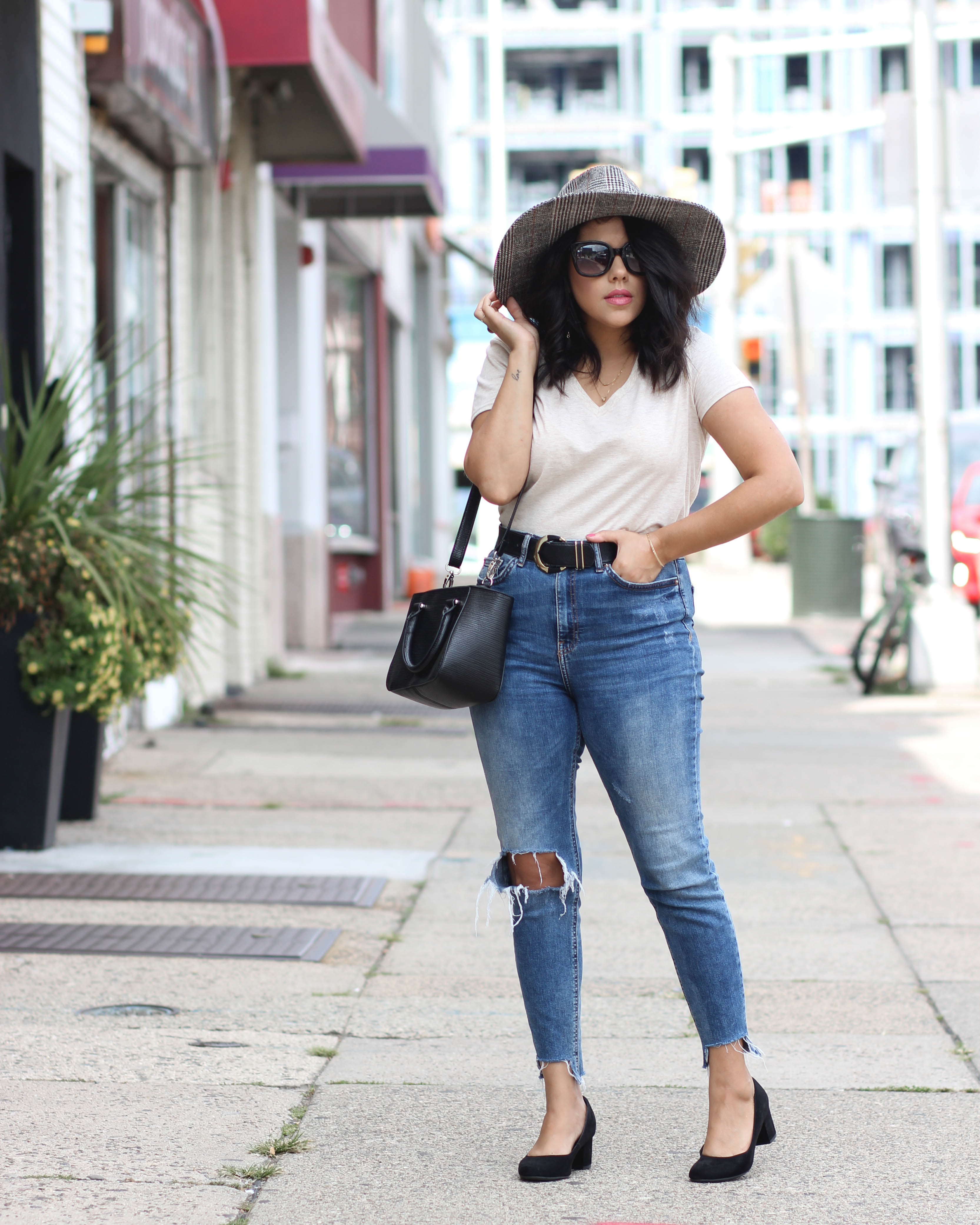 lifestyle blogger naty michele street style in wide brim hat and denim