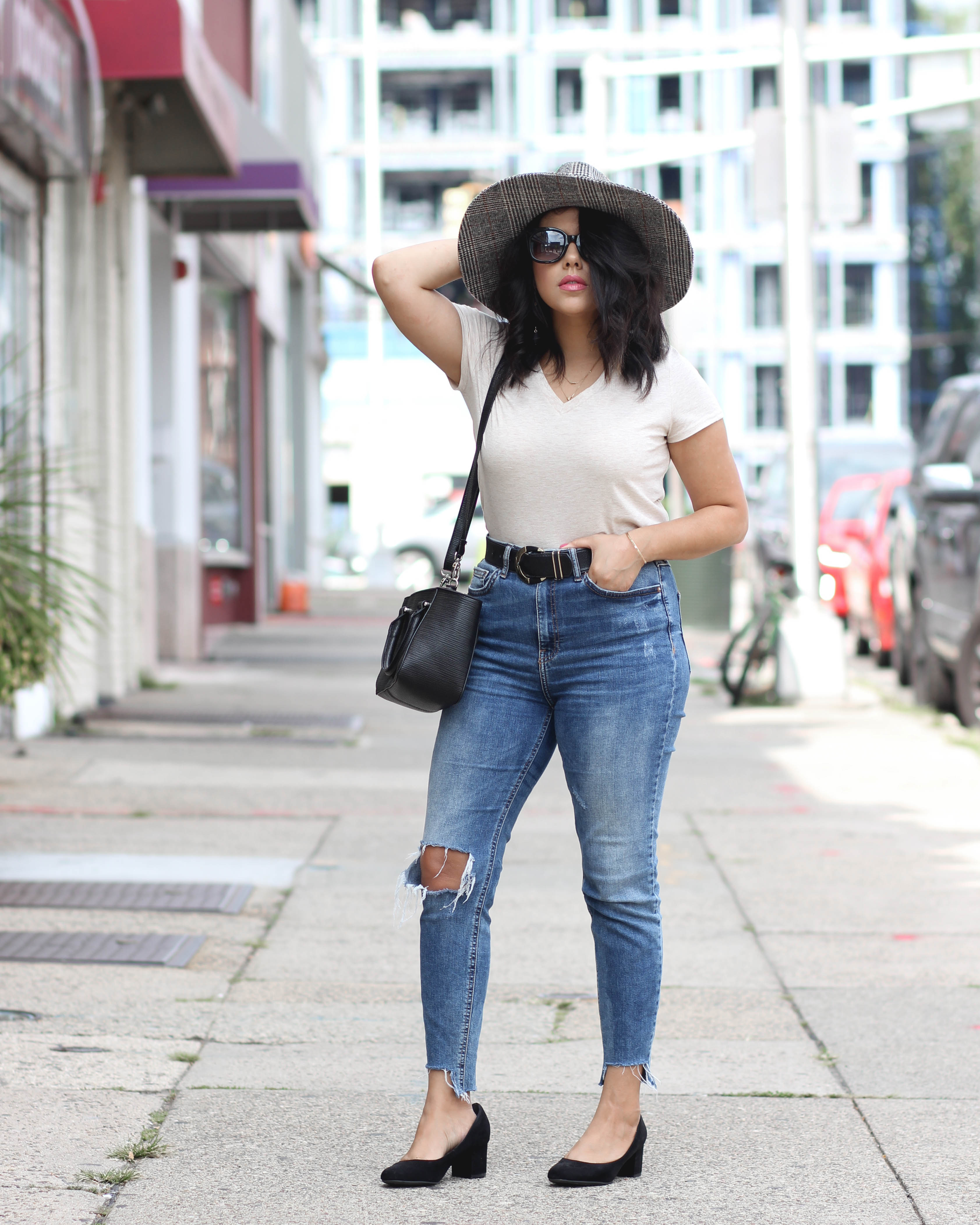 Lifestyle blogger Naty Michele wearing a wide brim hat and jeans