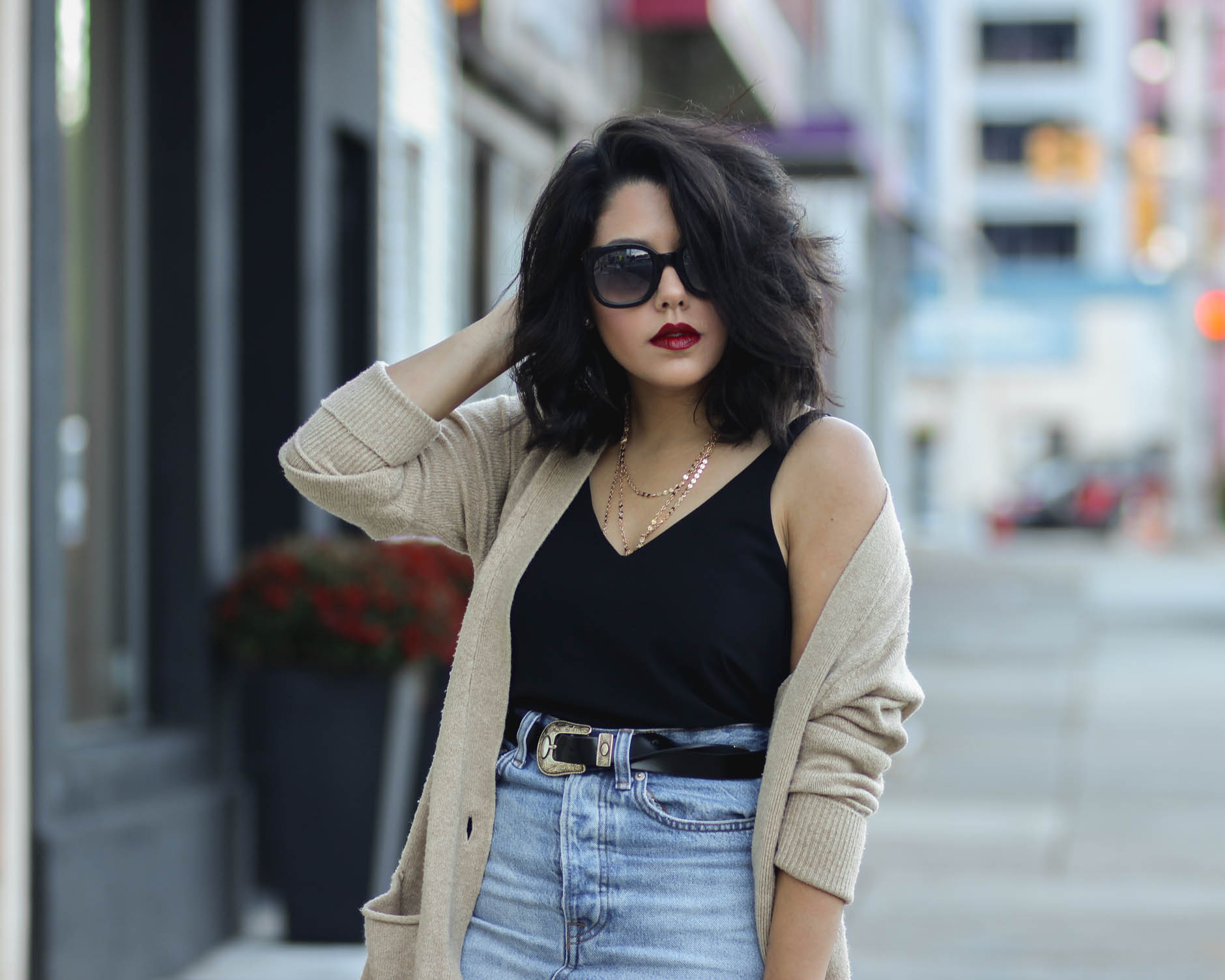 close up shot of style blogger naty michele wearing an oversized cardigan