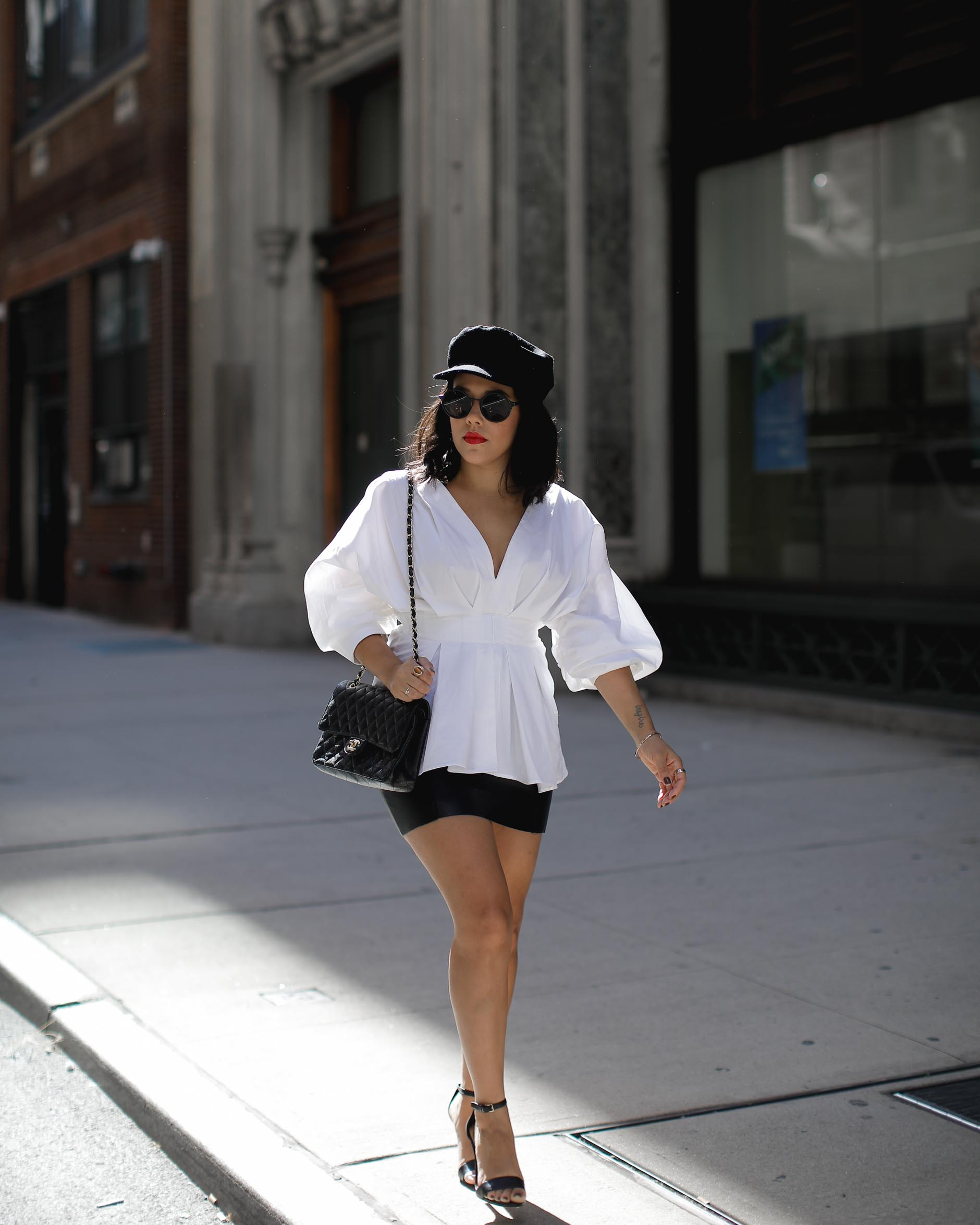 lifestyle blogger naty michele walking in statement statement sleeves at nyfw