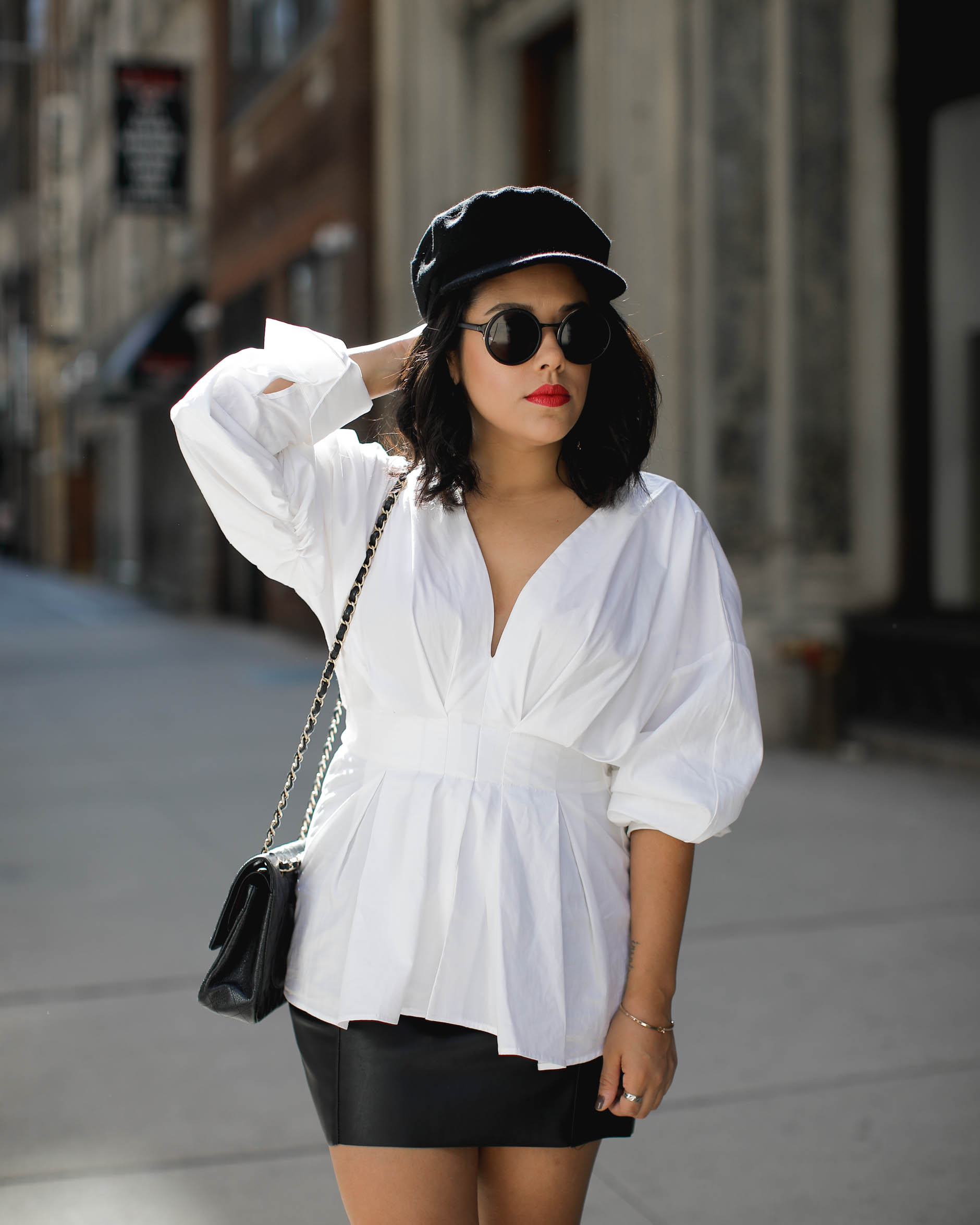 lifestyle blogger naty michele wearing statement sleeves and cabbie hat