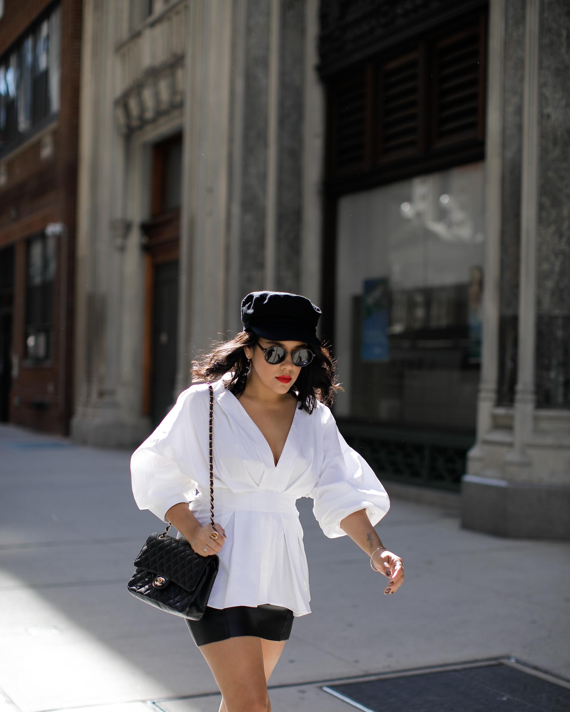 lifestyle blogger naty michele wearing statement sleeves at nyfw