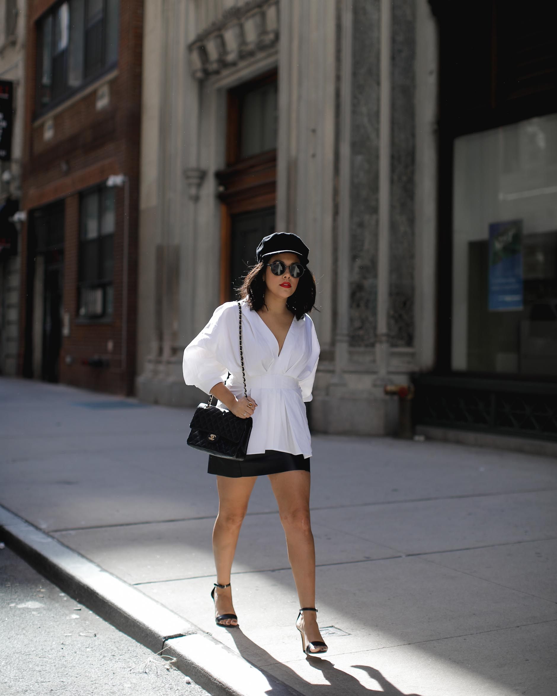 lifestyle blogger naty michele wearing statement sleeves and walking at nyfw
