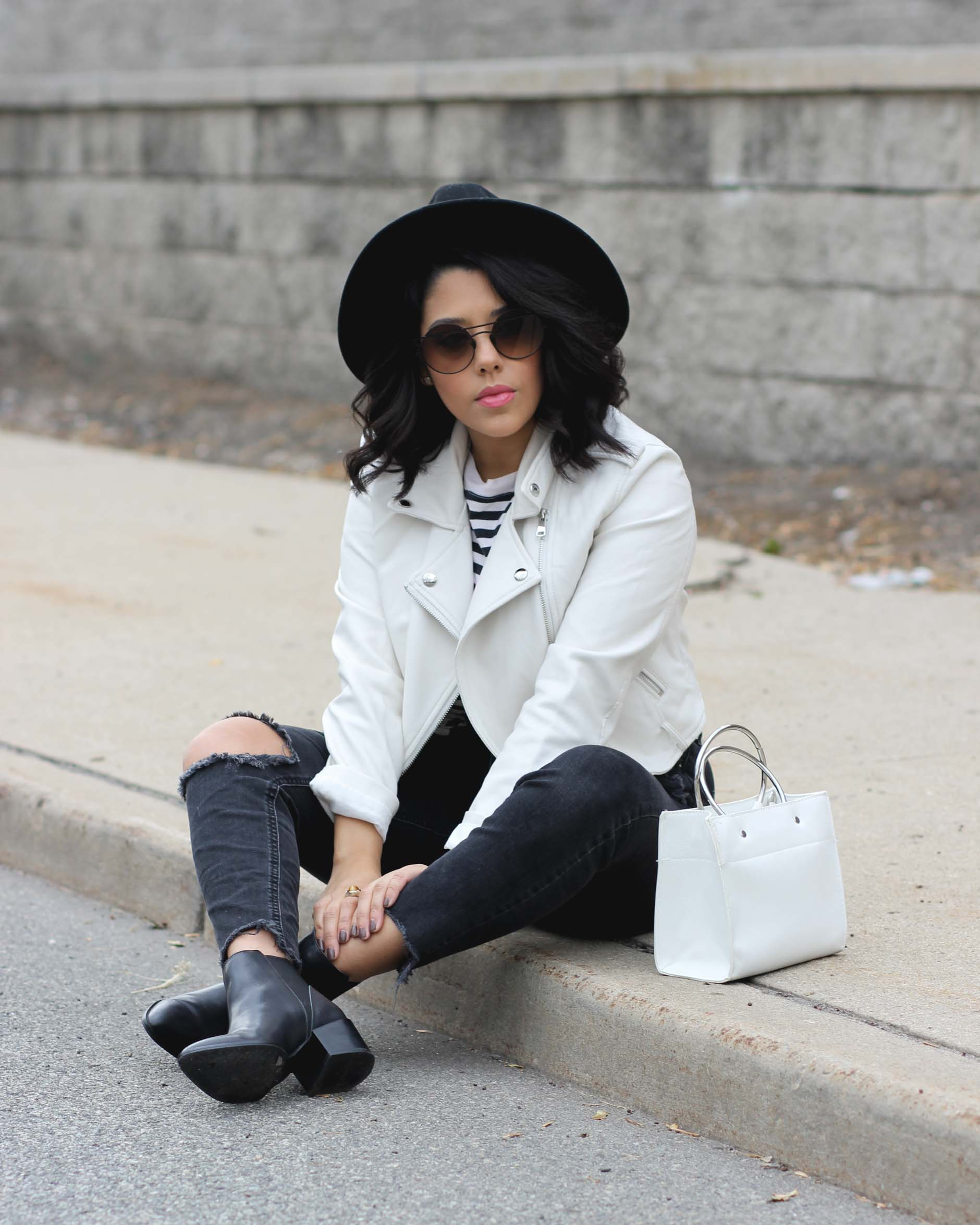 lifestyle blogger naty michele wearing a white faux leather jacket black denim and black boots