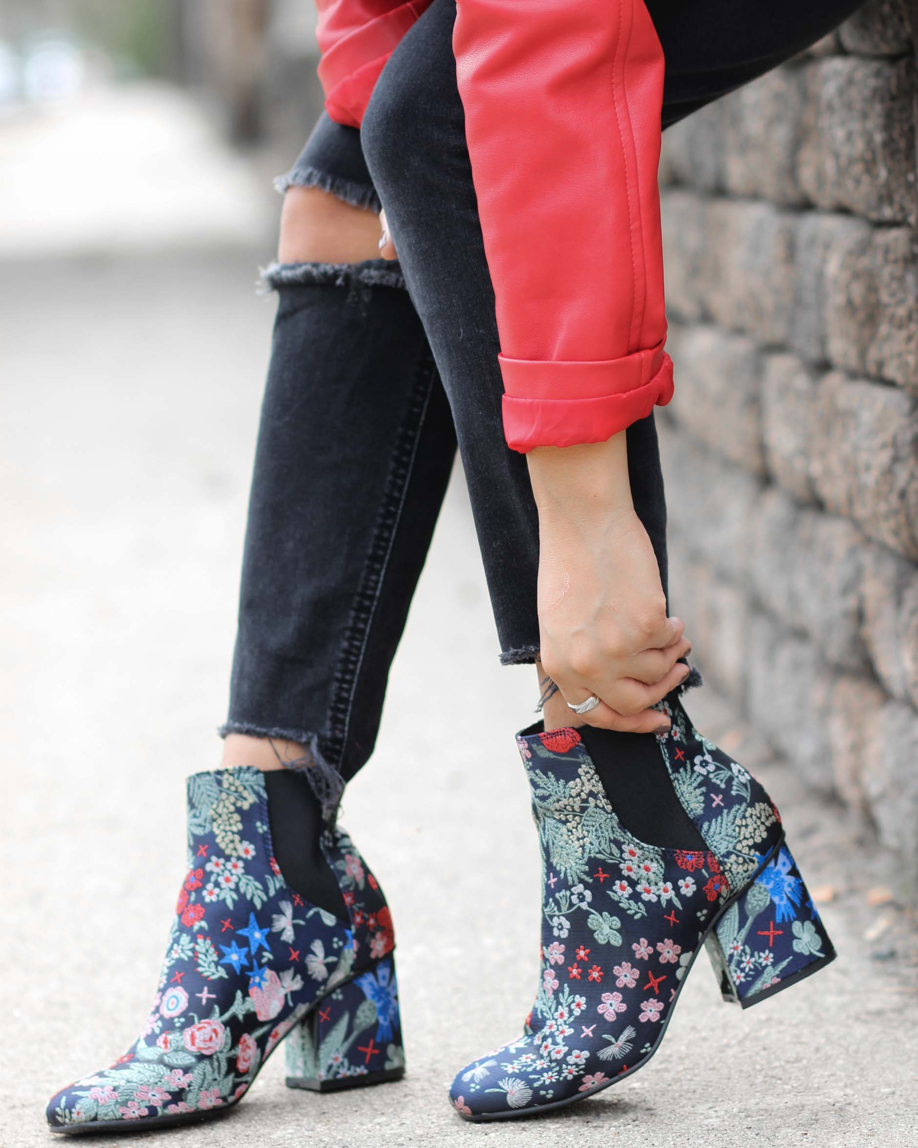 close up of naty michele wearing floral booties