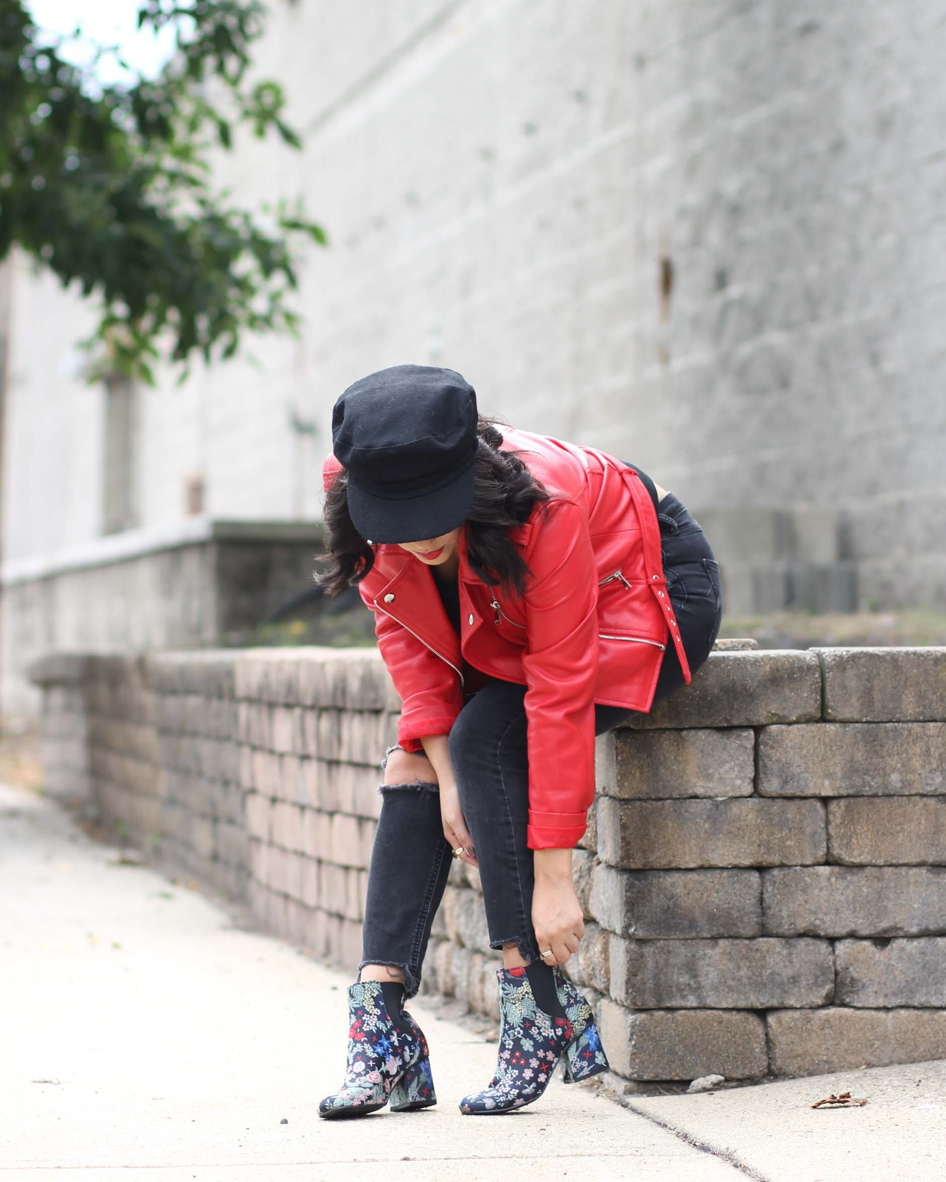 lifestyle blogger naty michele wearing floral booties and red leather jacket