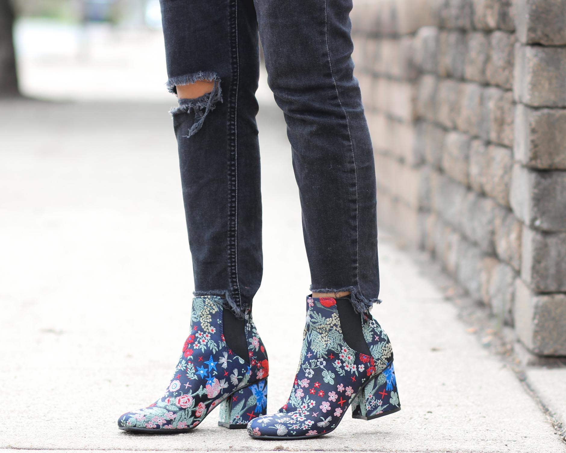 close up of lifestyle blogger naty michele wearing floral booties