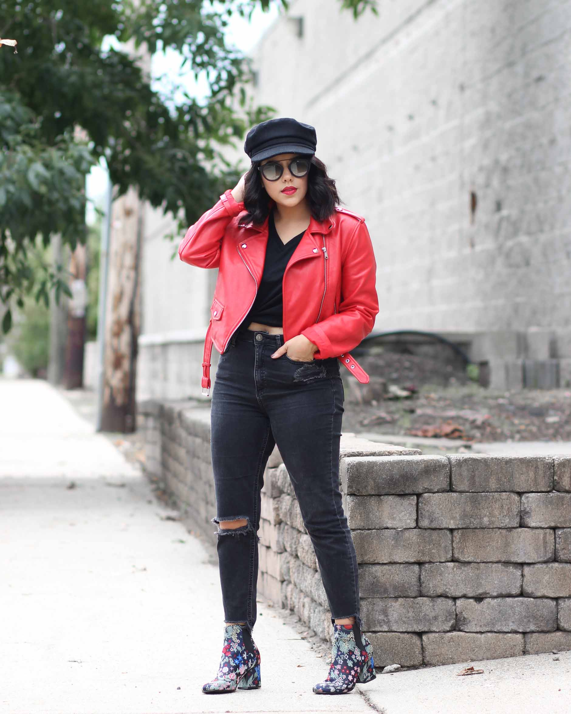 lifestyle blogger naty michele wearing red leather jacket and floral booties