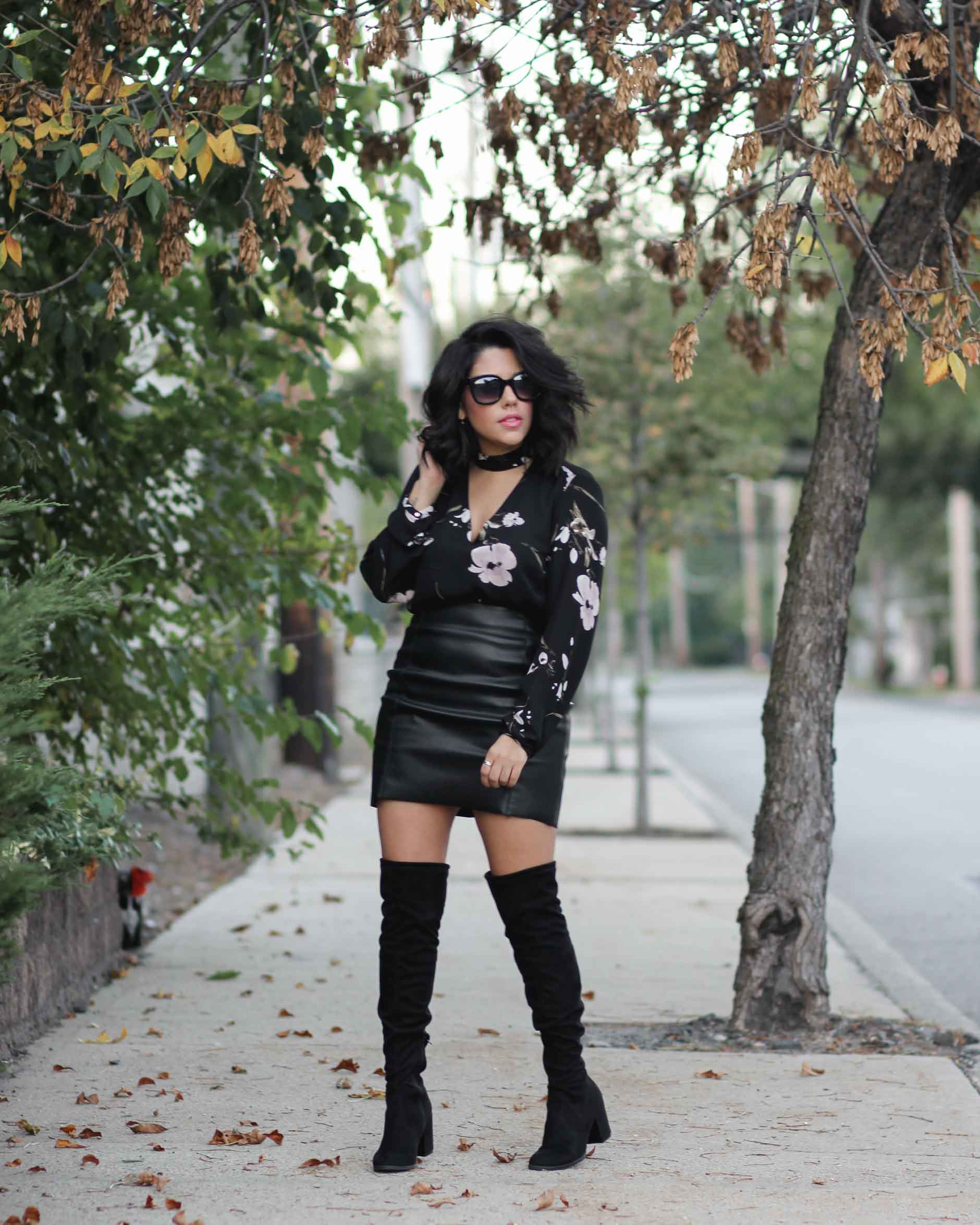 lifestyle blogger naty michele wearing OTK boots and a leather skirt