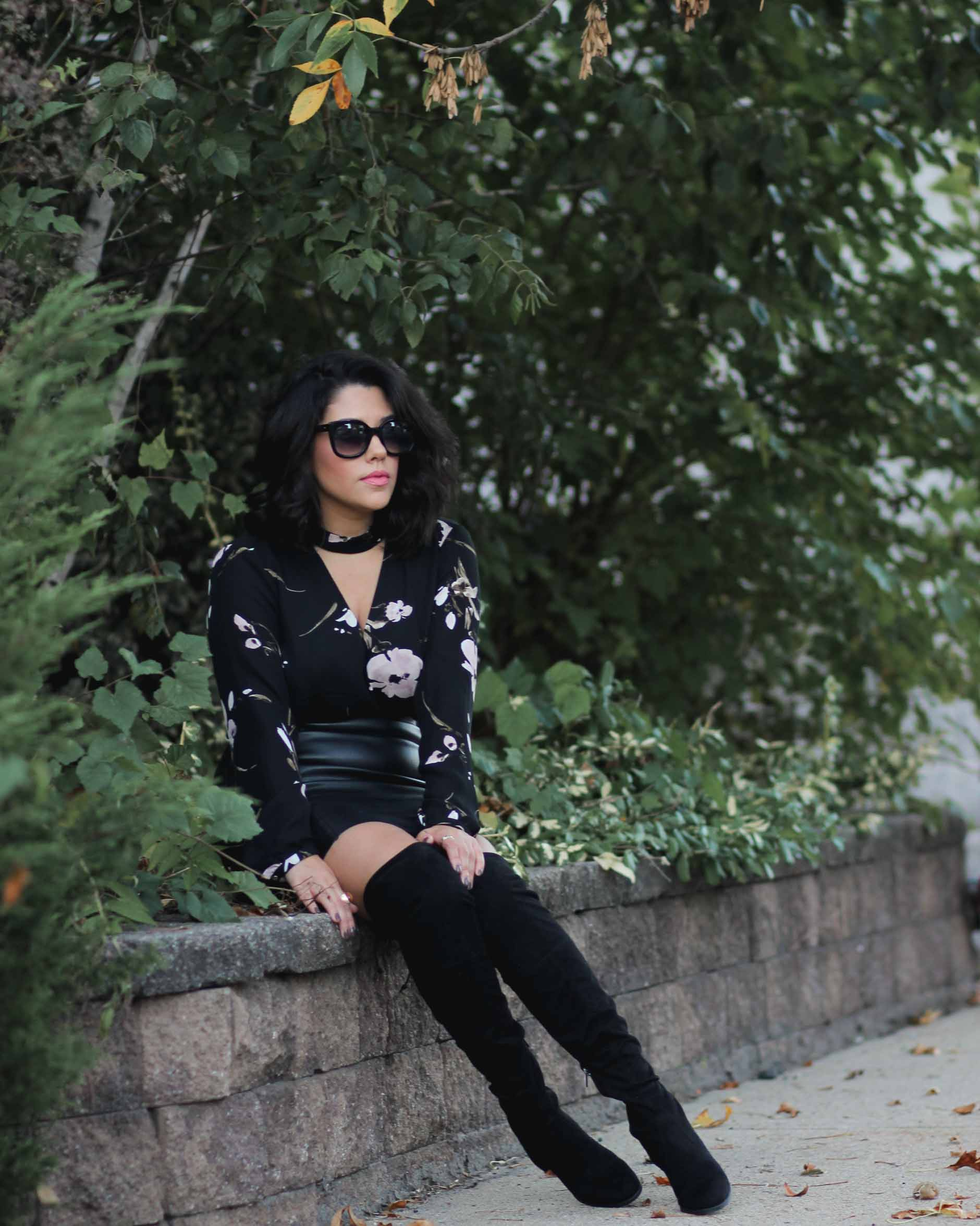 lifestyle blogger naty michele sitting down in otk boots