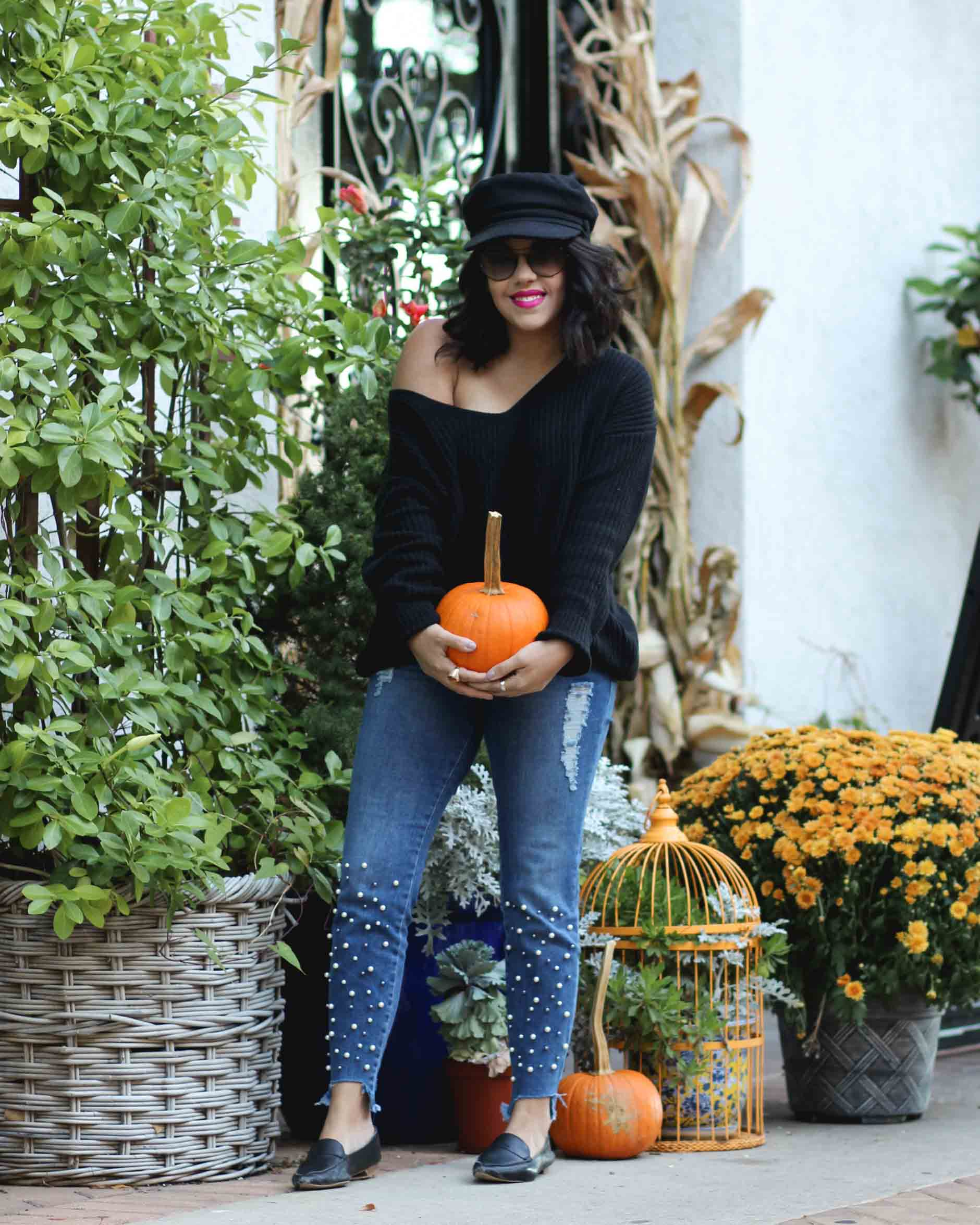 ab0faf3e871 lifestyle blogger naty michele wearing pearl jeans holding a pumpkin