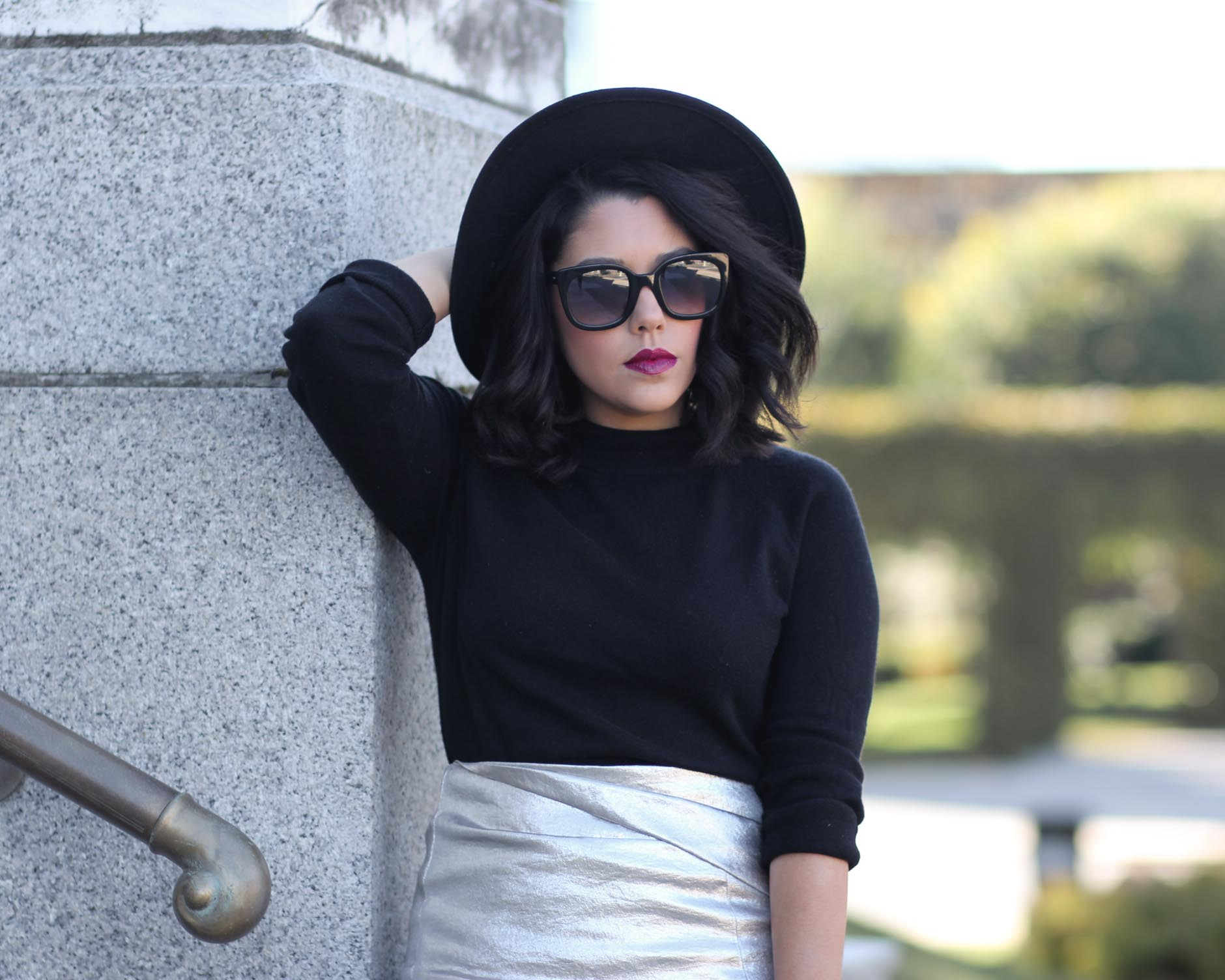 close up of lifestyle blogger naty michele in a black sweater and wide brim hat