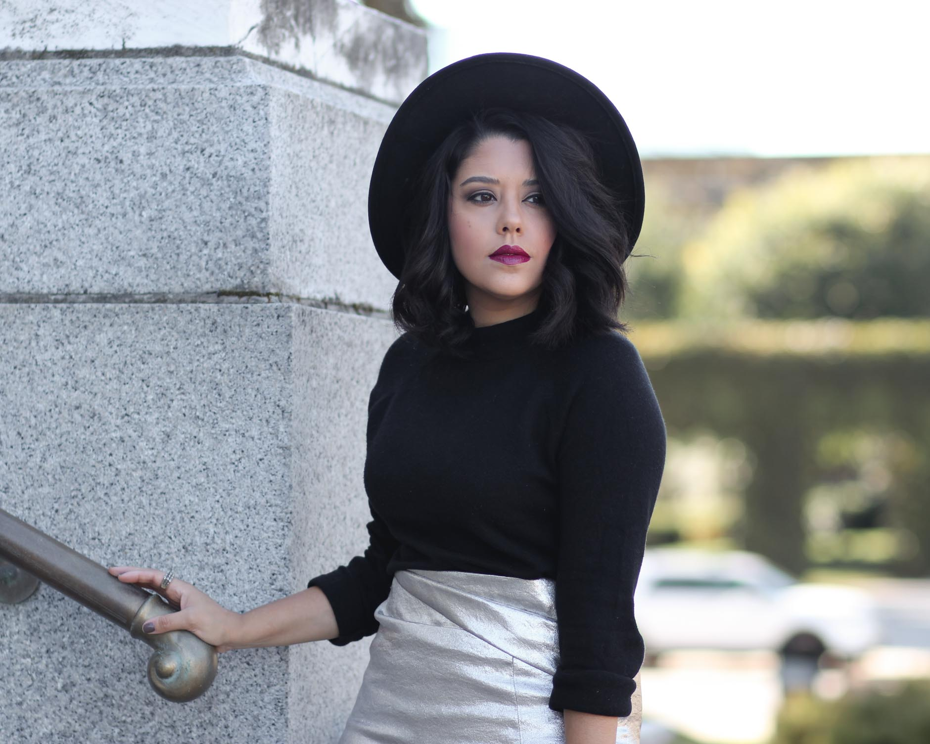 close up of naty michele wearing a wide brim hat and black sweater