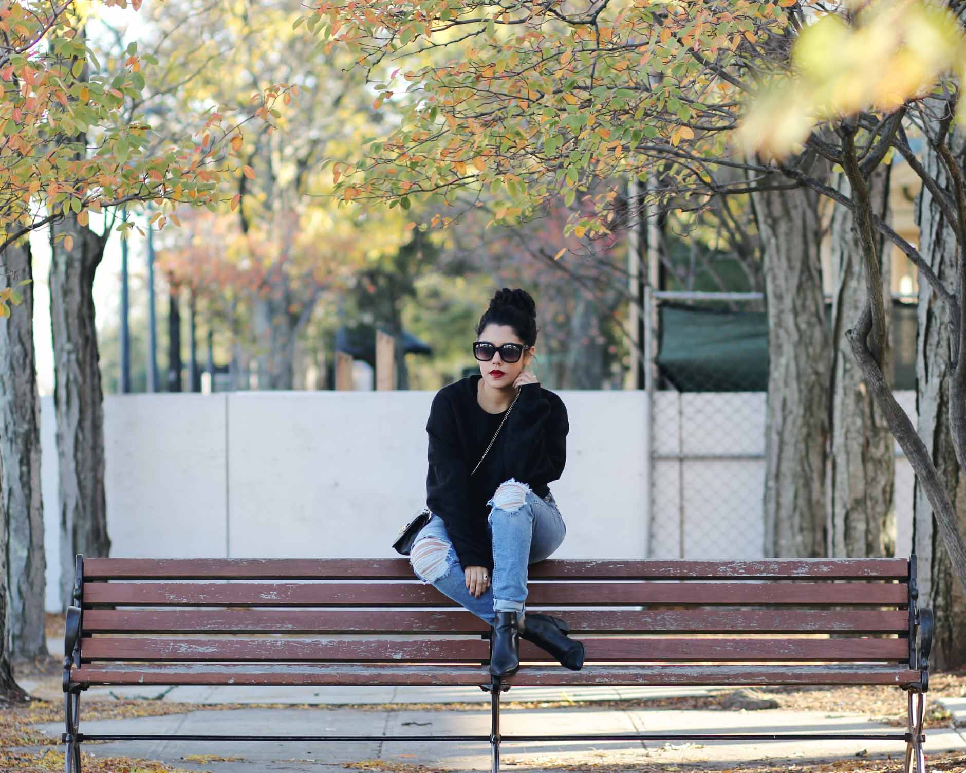 naty michele wearing cropped sweatshirt and denim