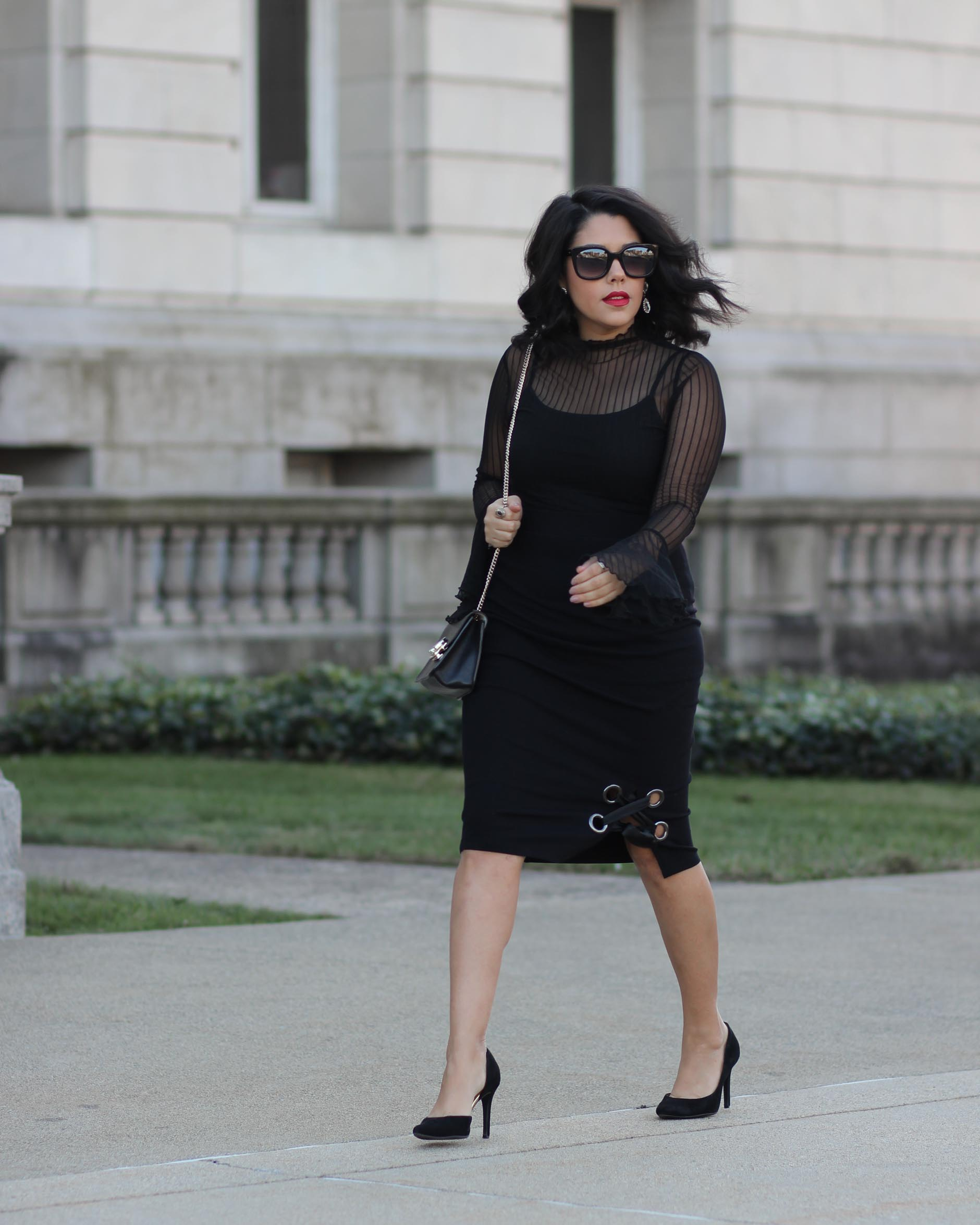 lifestyle blogger naty michele wearing a lace up skirt and sheer bell sleeve top from project runway