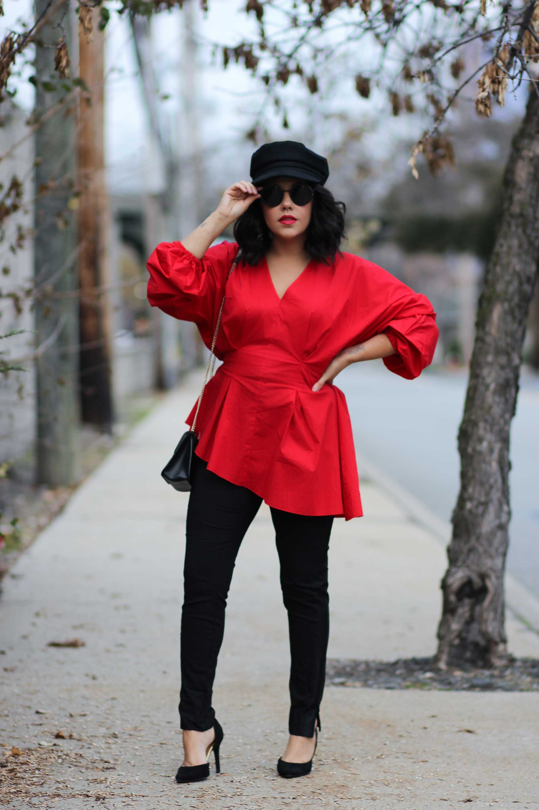 naty michele wearing a red puffy sleeve top from project runway and jcpenney