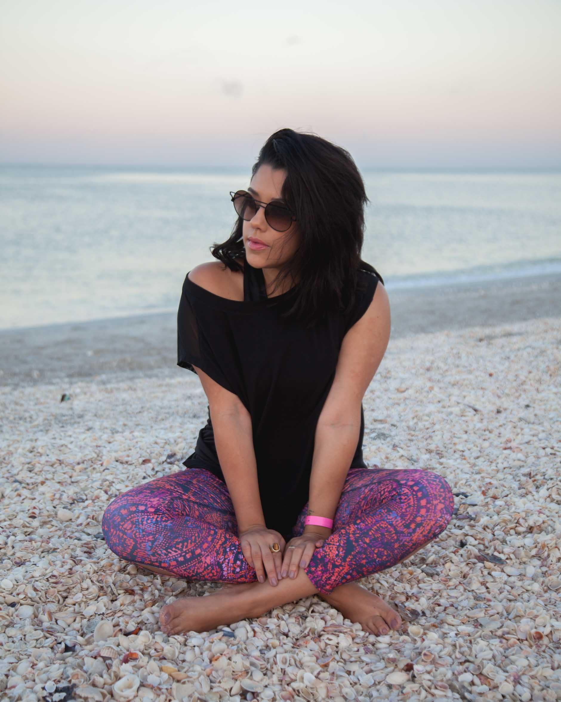 lifestyle blogger naty michele wearing printed jockey leggings on the beach