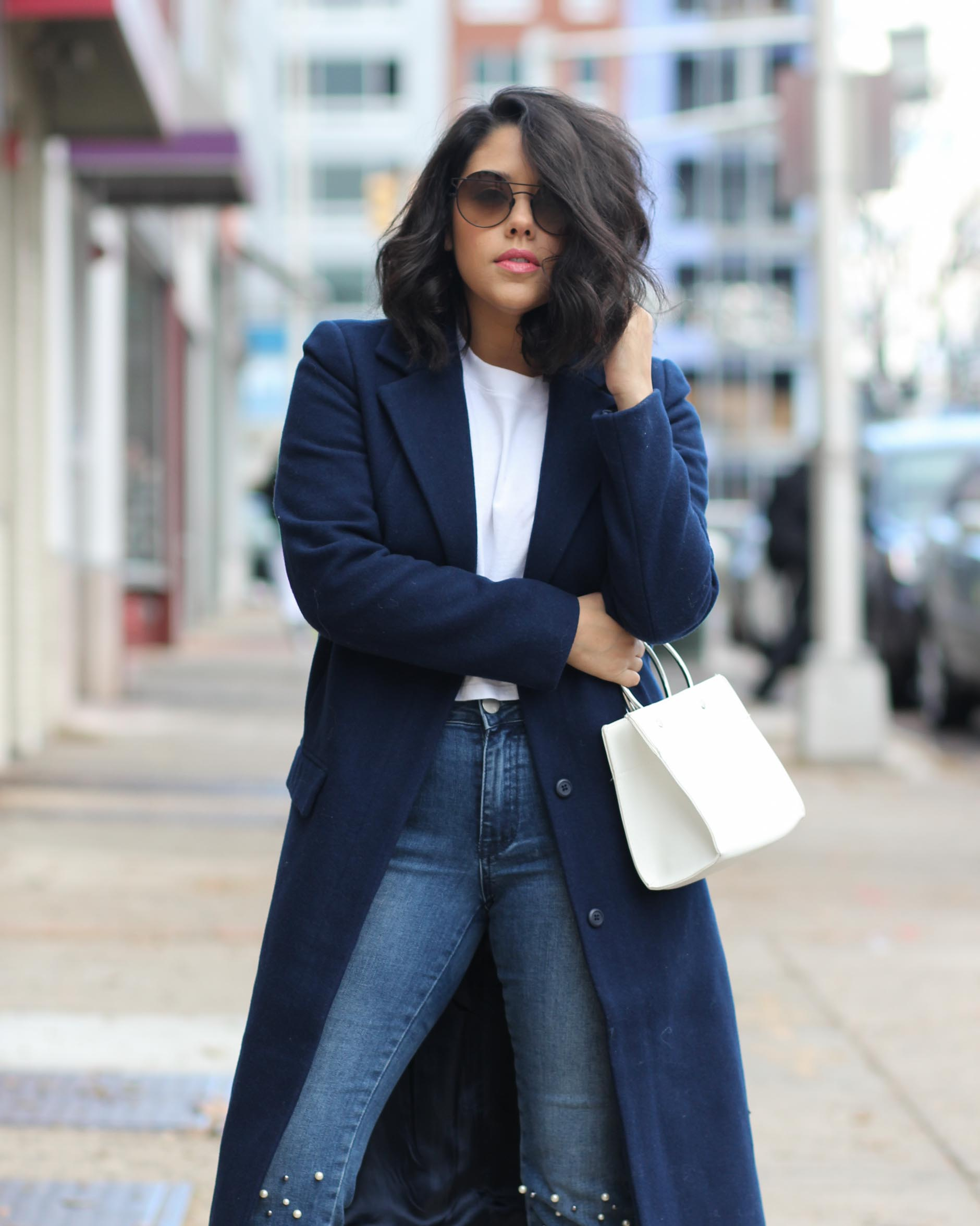 lifestyle blogger naty michele wearing pearl jeans and a navy coat