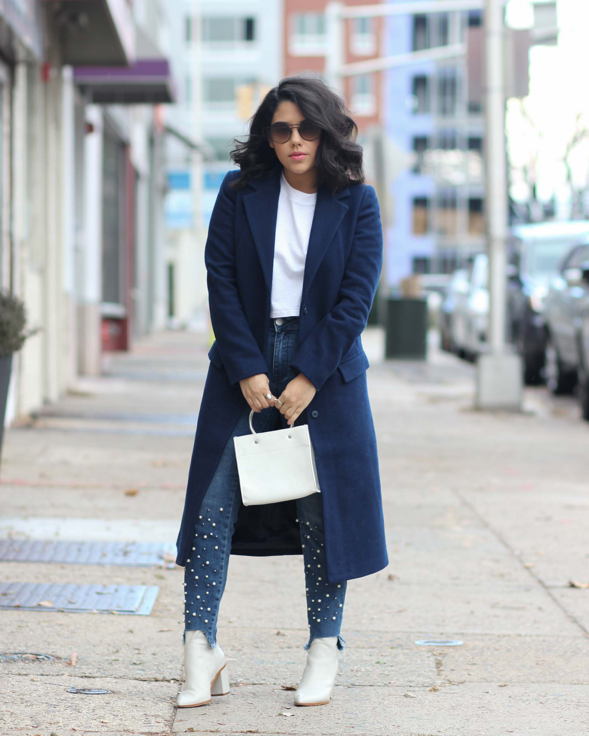 lifestyle blogger naty michele wearing a navy coat and pearl jeans