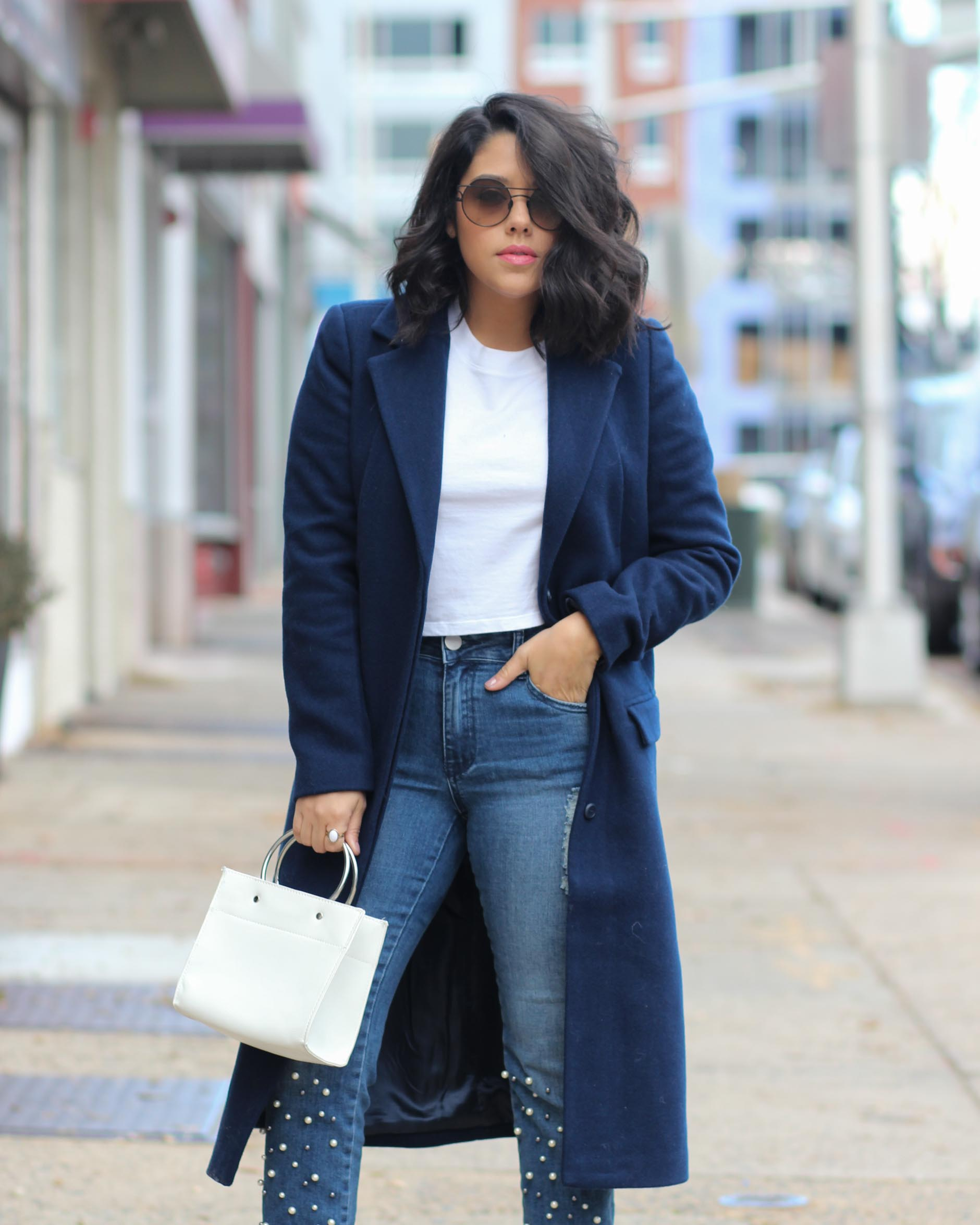 lifestyle blogger naty michele wearing navy coat and pearl jeans