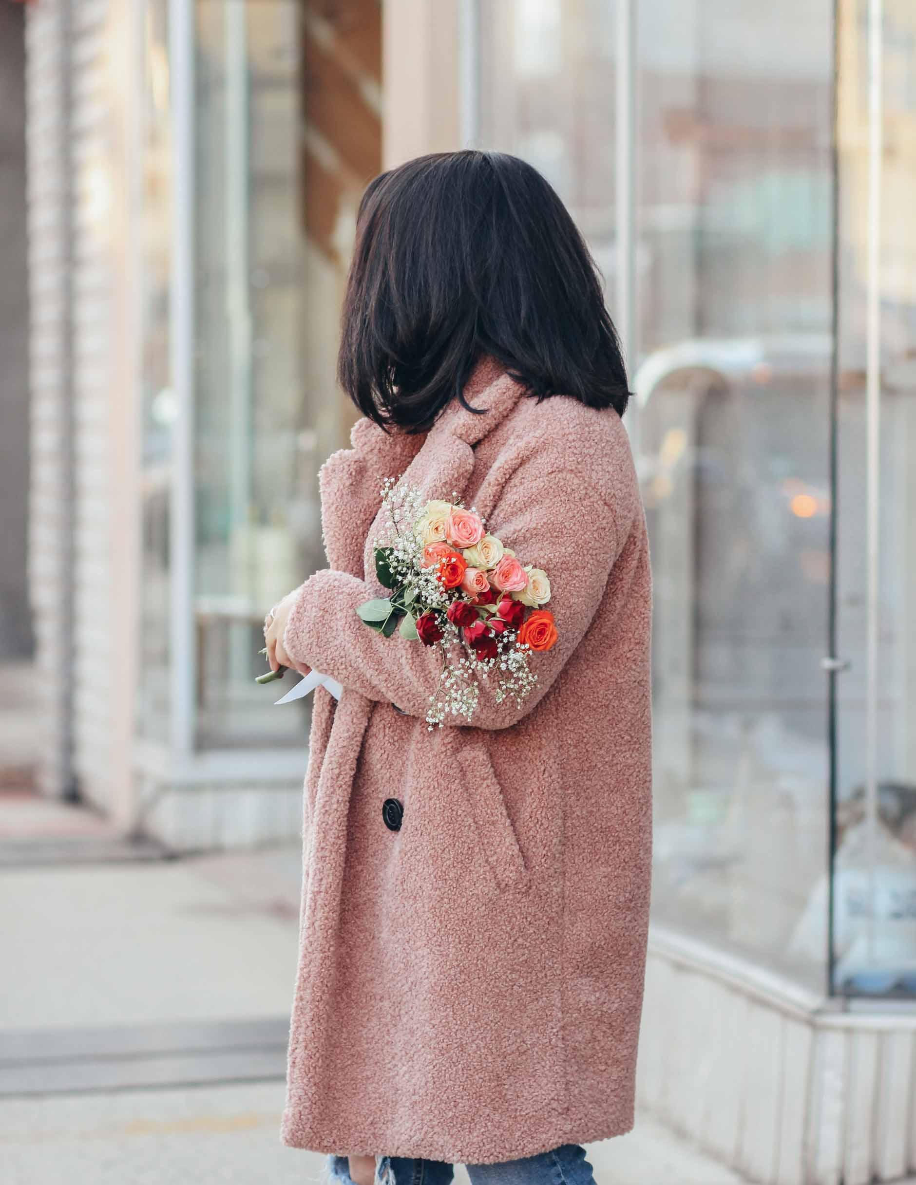 lifestyle blogger naty michele holding roses