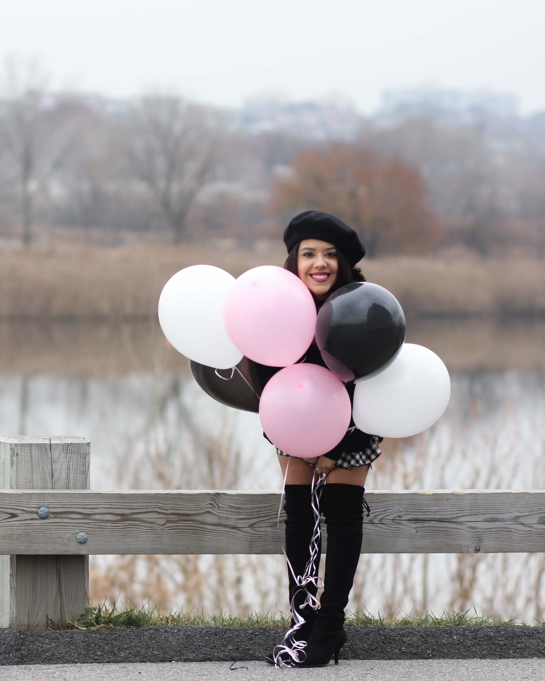 lifestyle blogger naty michele wearing beret with balloons