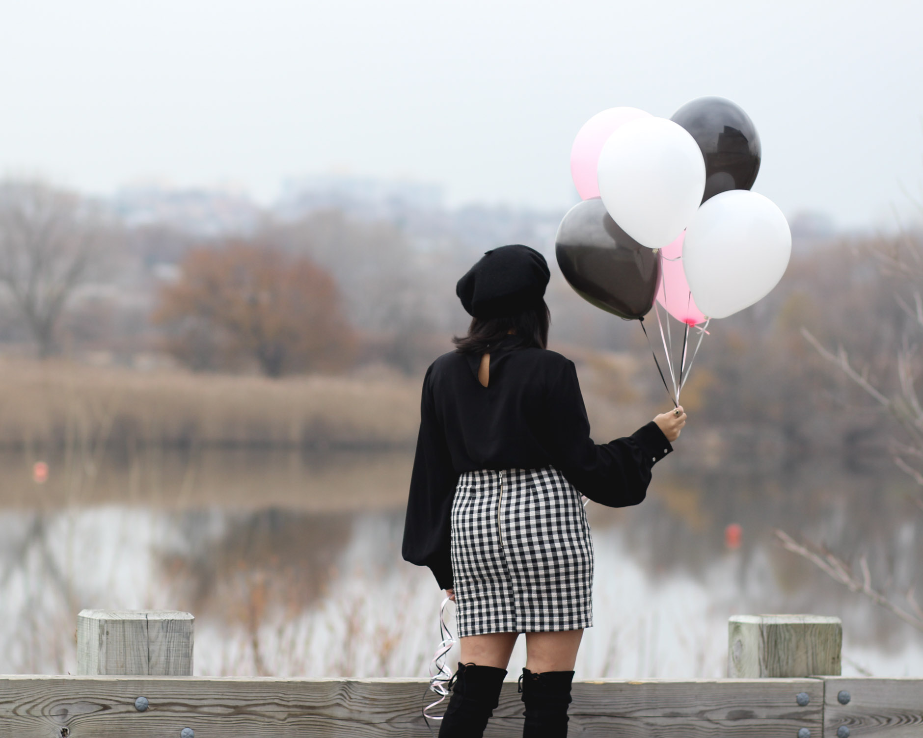 lifestyle blogger naty michele holding balloons