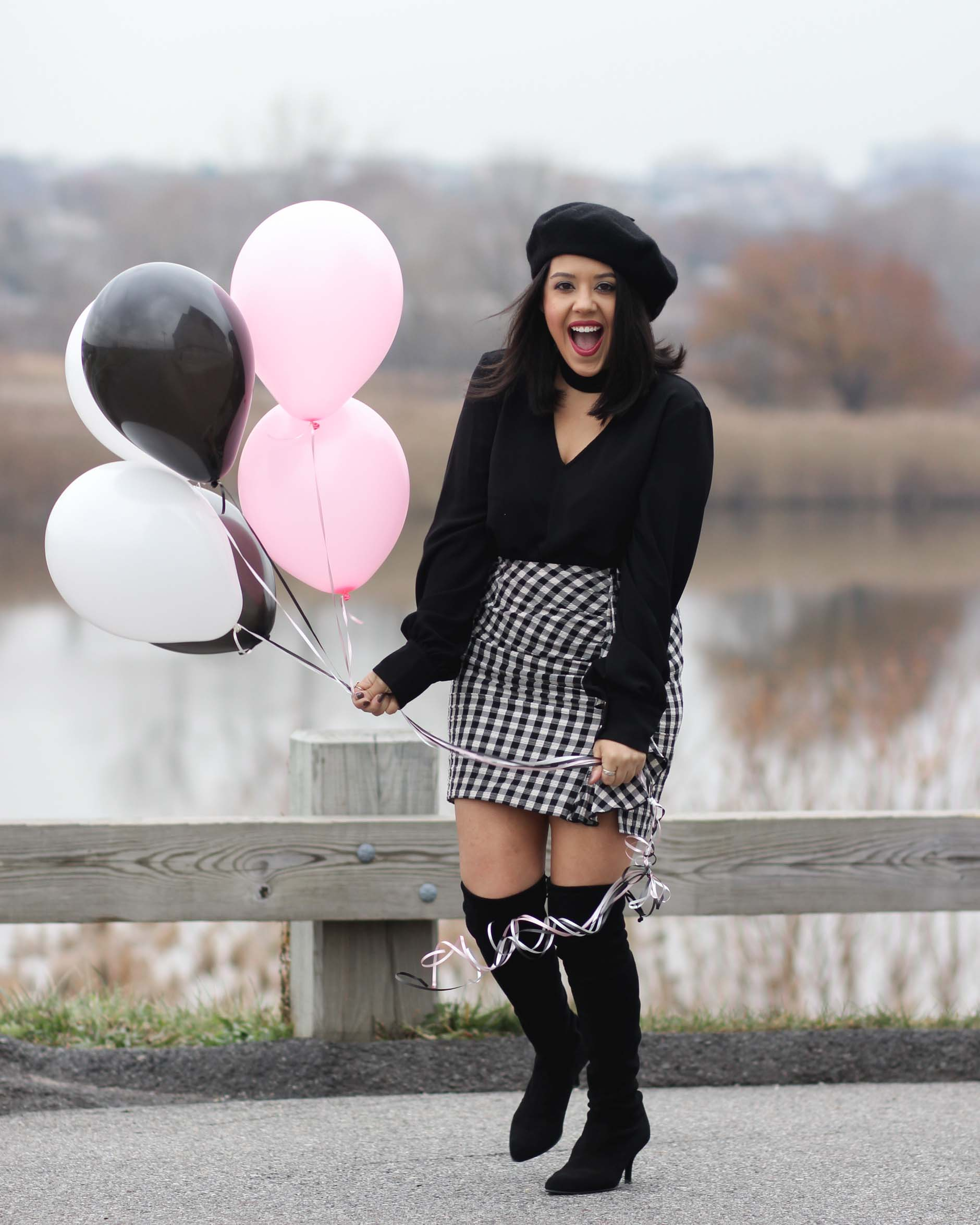 naty michele wearing beret and otk boots holding balloons