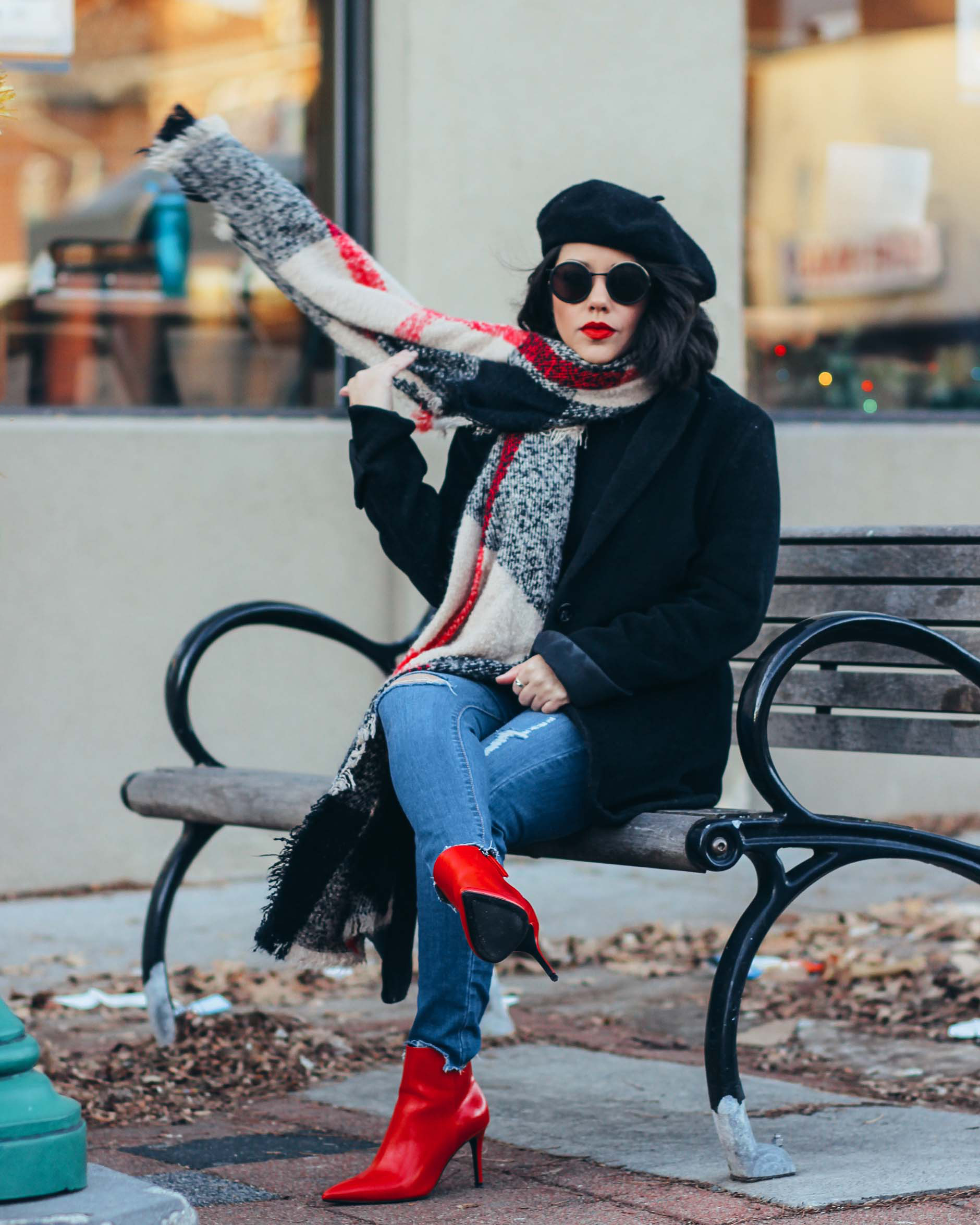 naty michele wearing a beret, red boots and plaid scarf