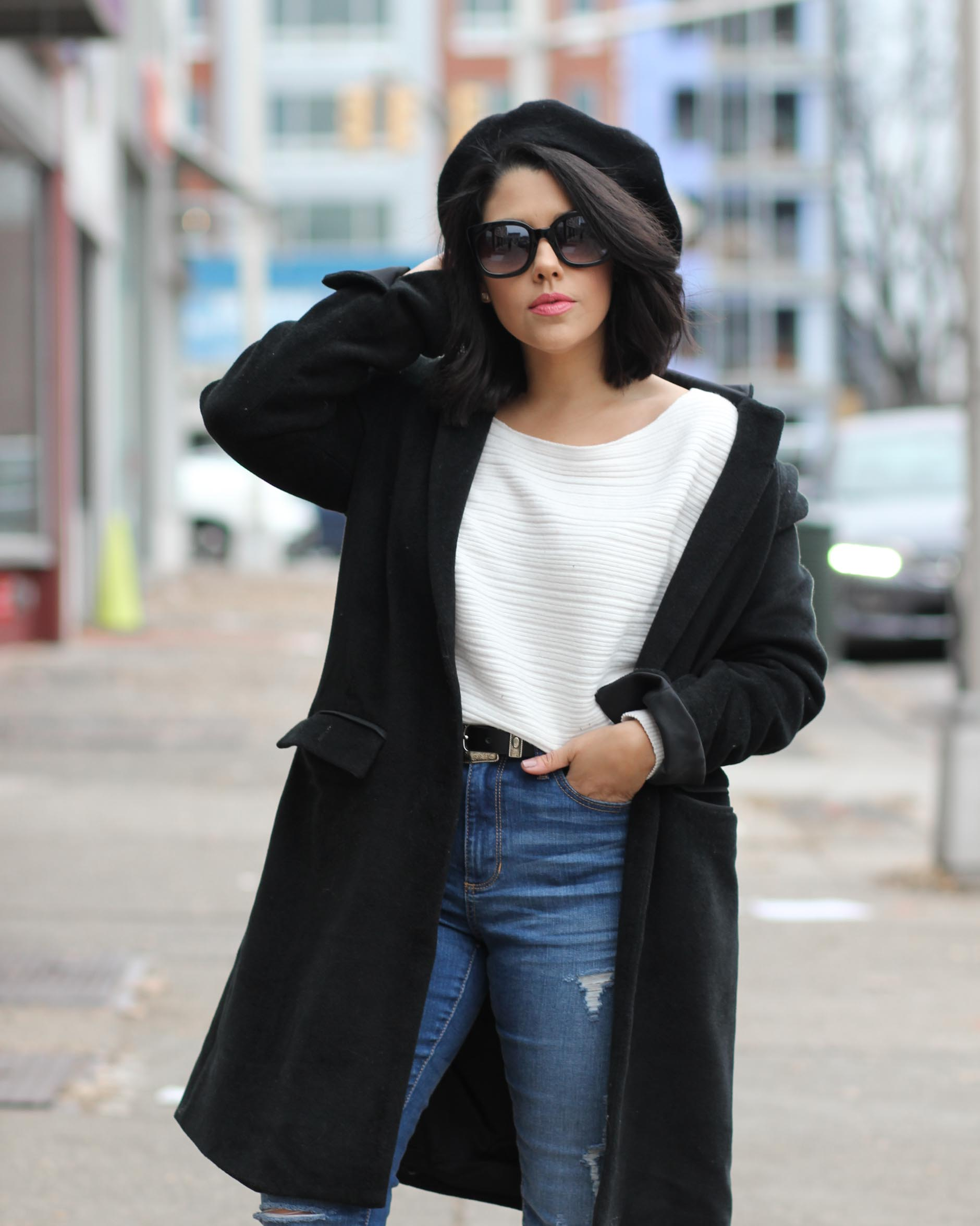 lifestyle blogger naty michele with short hair wearing sweater and black coat