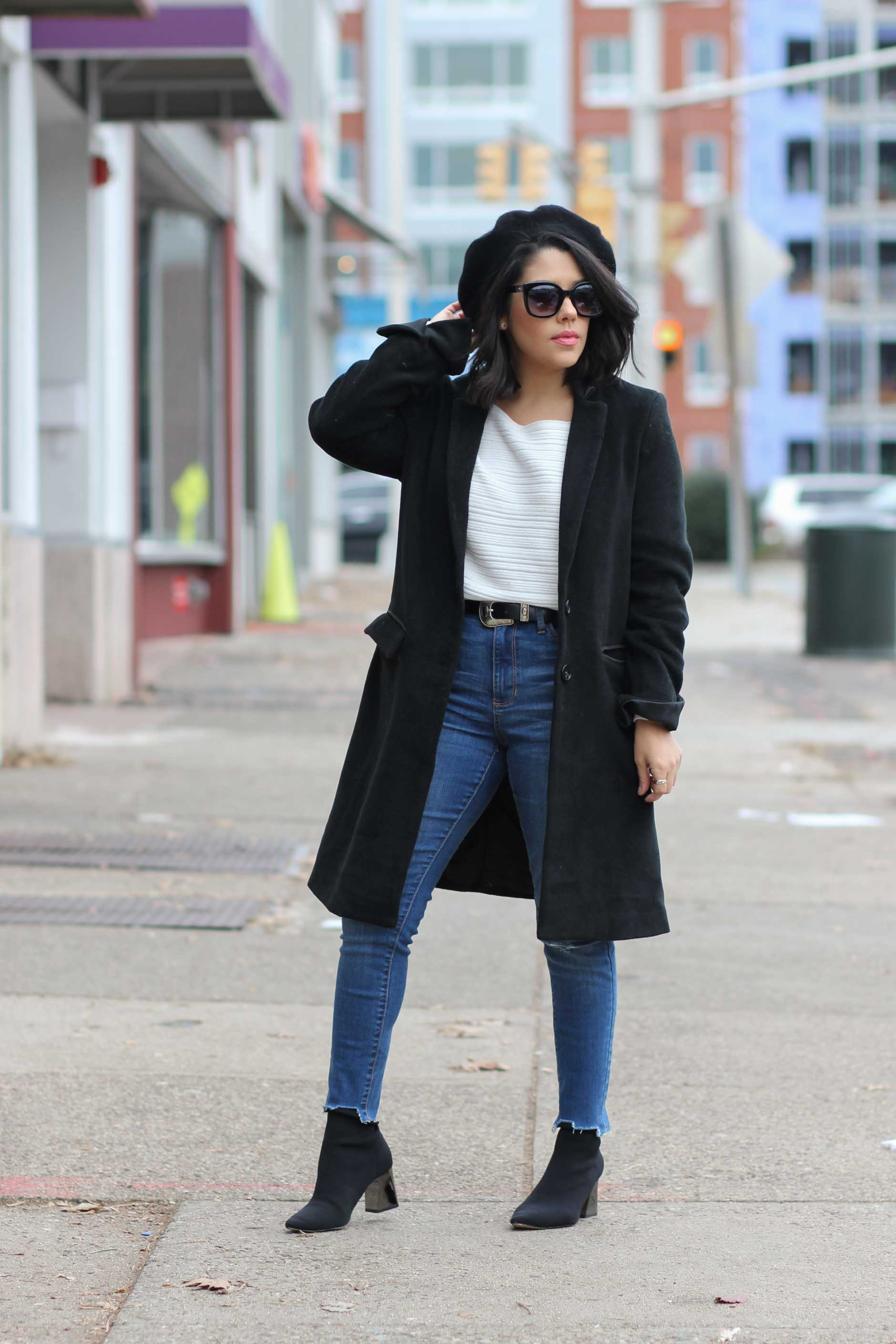 lifestyle blogger naty michele wearing denim with a beret and black coat