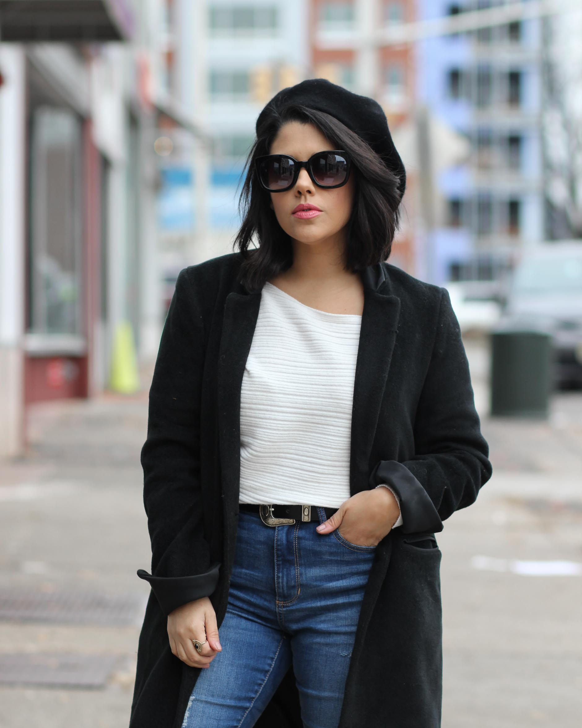 lifestyle blogger naty michele wearing a beret with a black coat