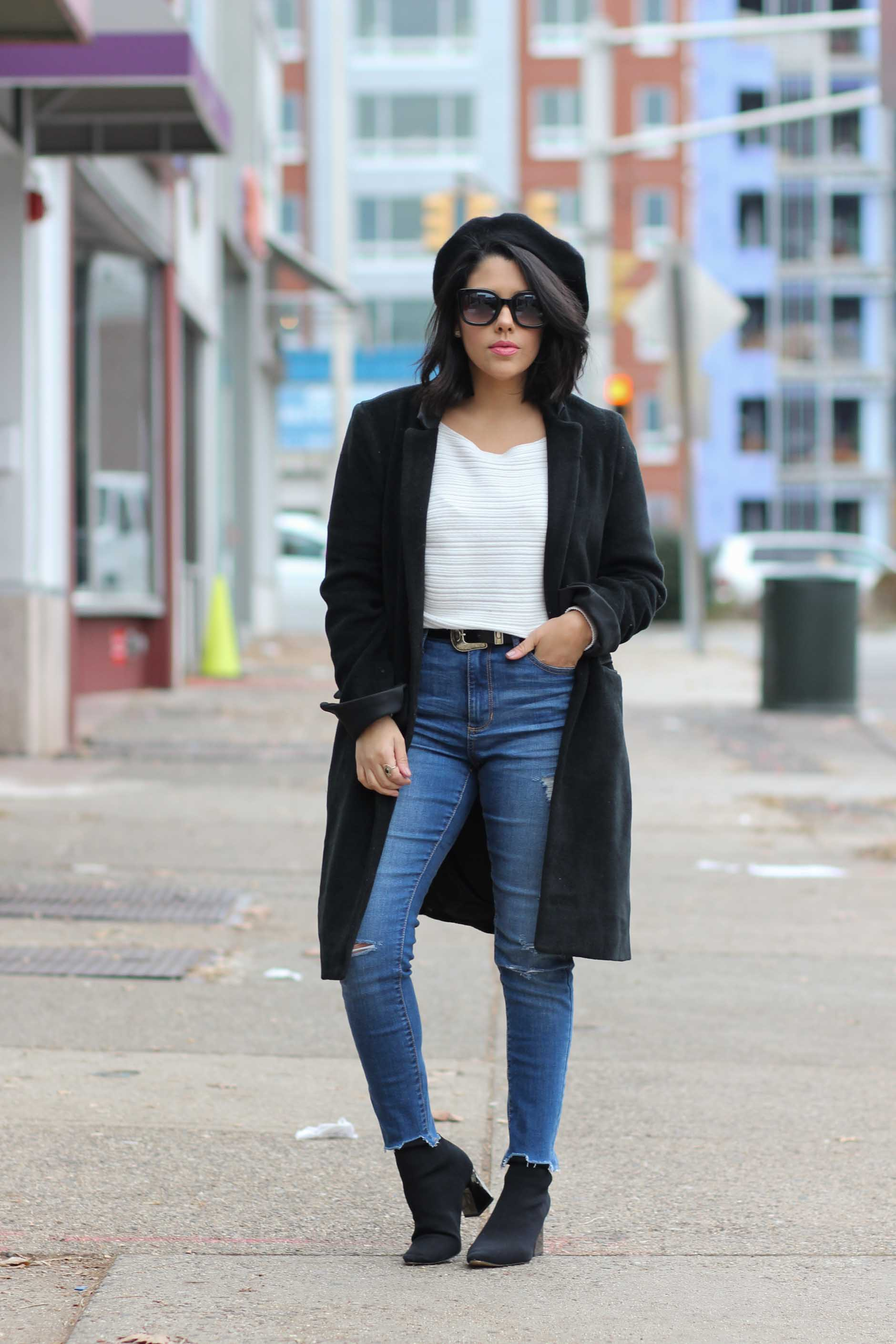 lifestyle blogger naty michele wearing a beret with denim and a black coat
