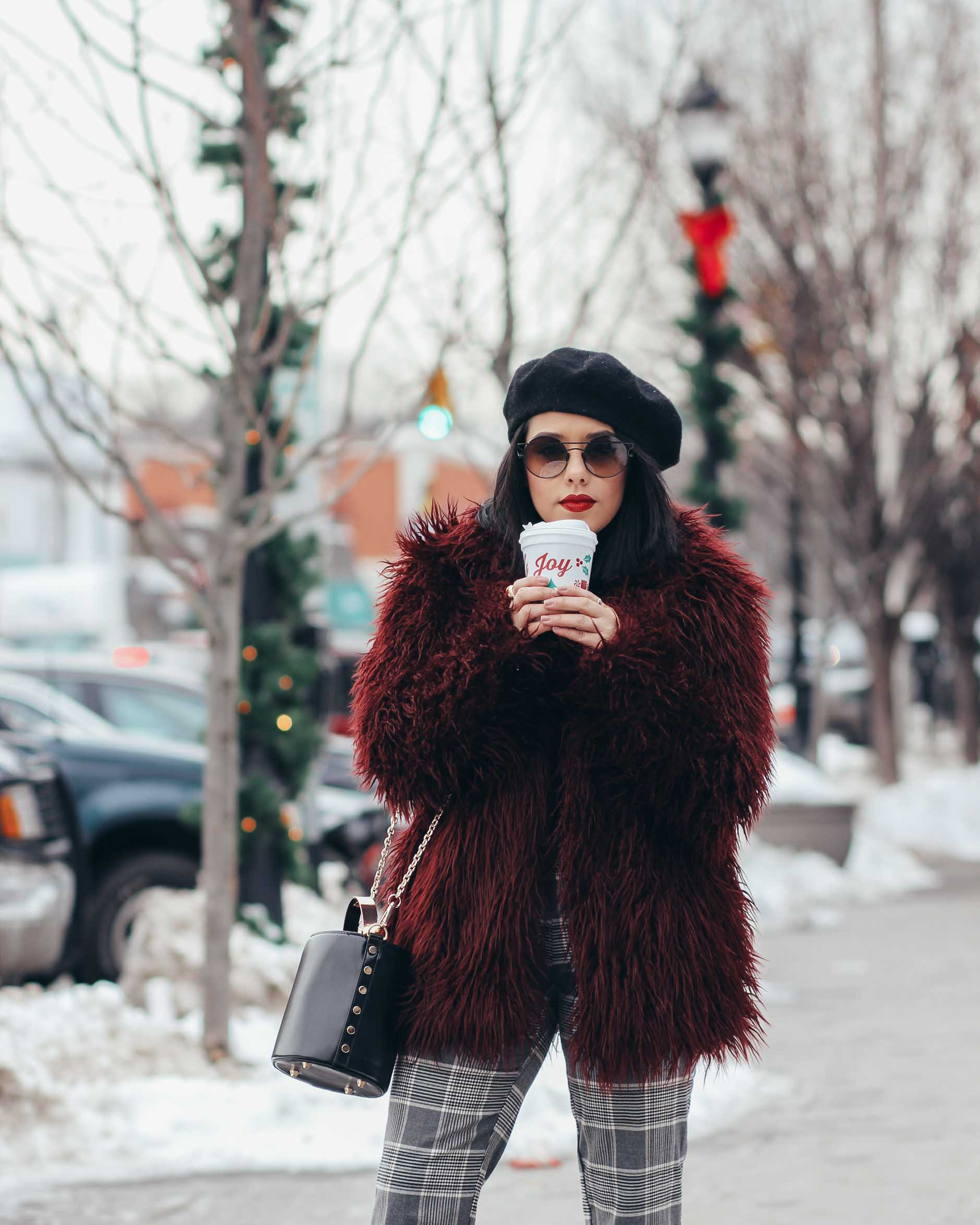 lifestyle blogger naty michele wearing faux fur coat and beret