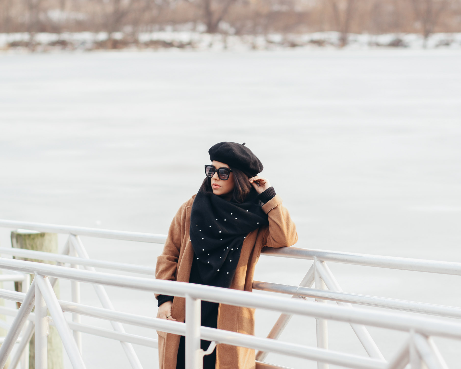 naty michele wearing a beret and peal scarf