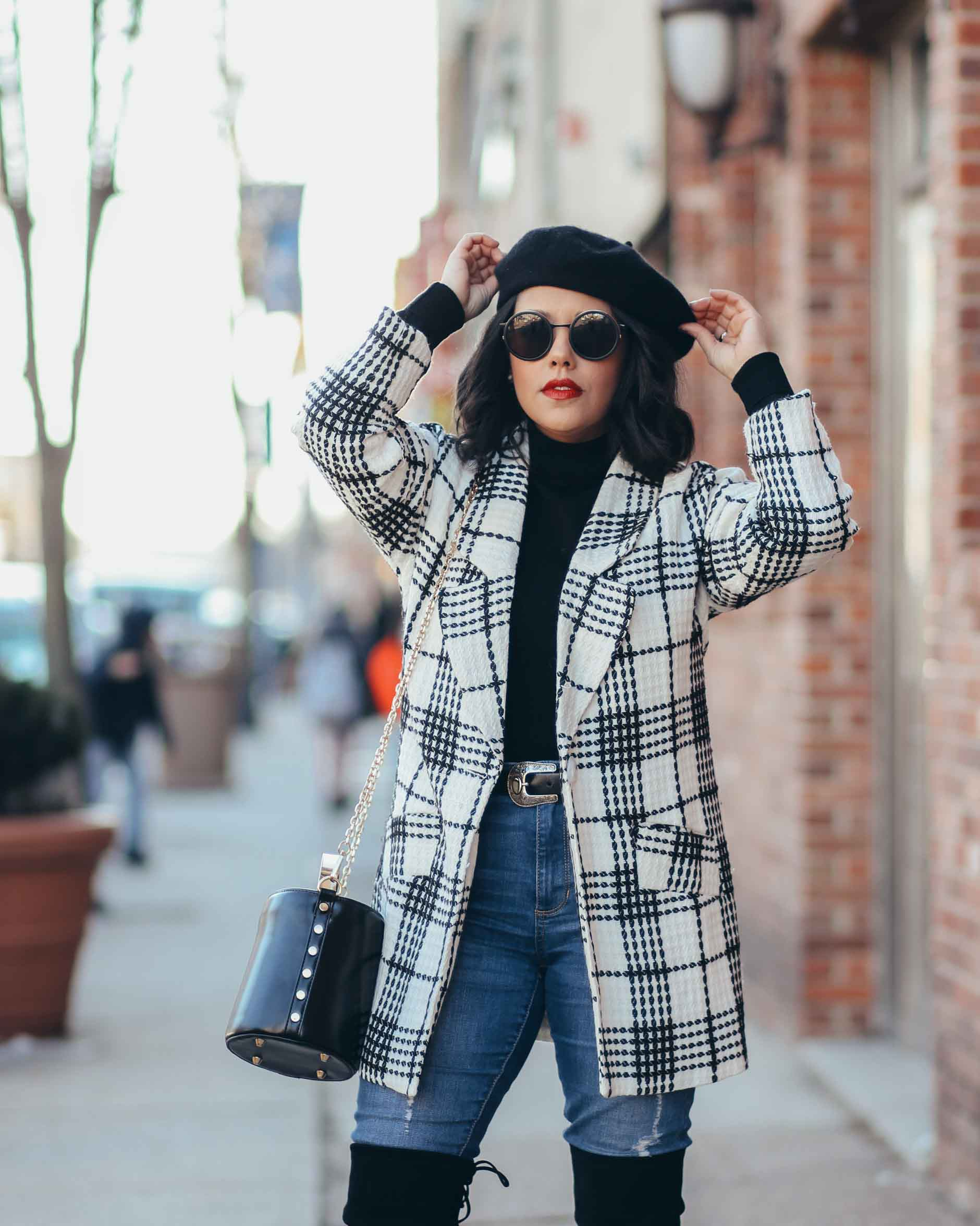 lifestyle blogger naty michele wearing a beret with a black and white coat and otk boots