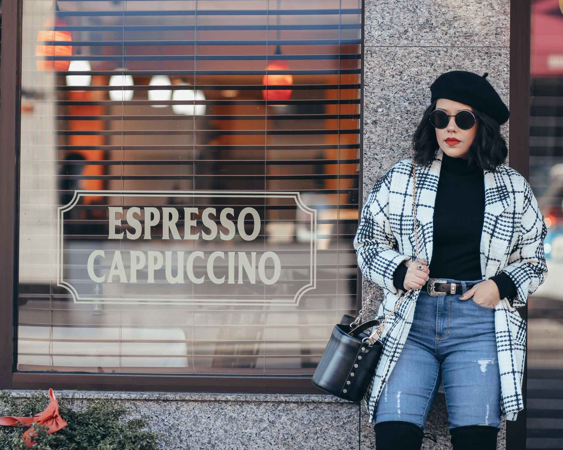 lifestyle blogger naty michele standing by coffee shop in a beret and white and black coat