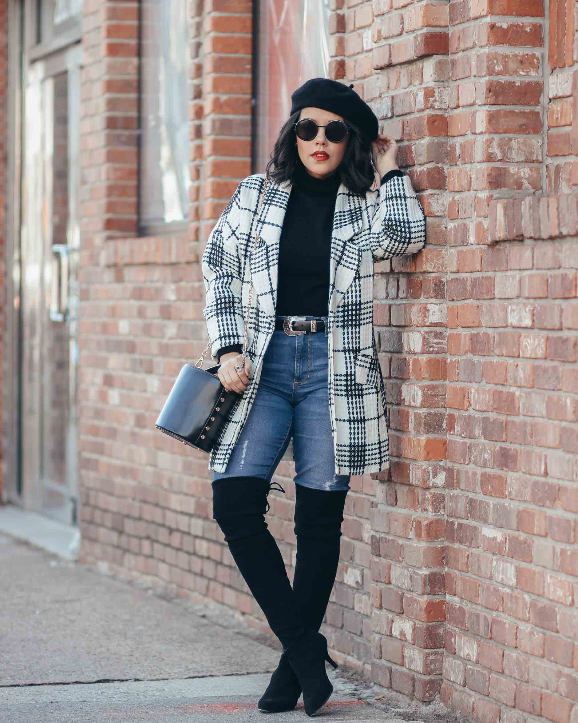 lifestyle blogger naty michele wearing a black and white coat with otk boots and denim