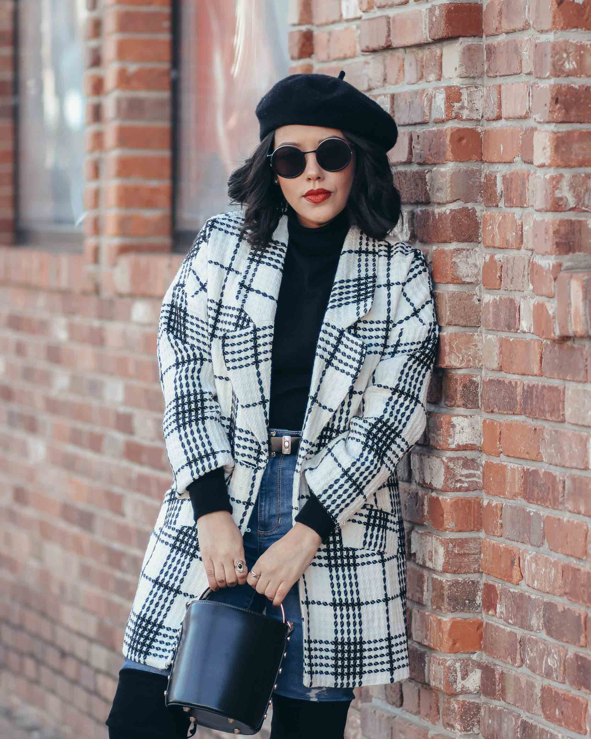 lifestyle blogger naty michele wearing a beret with a black and white coat
