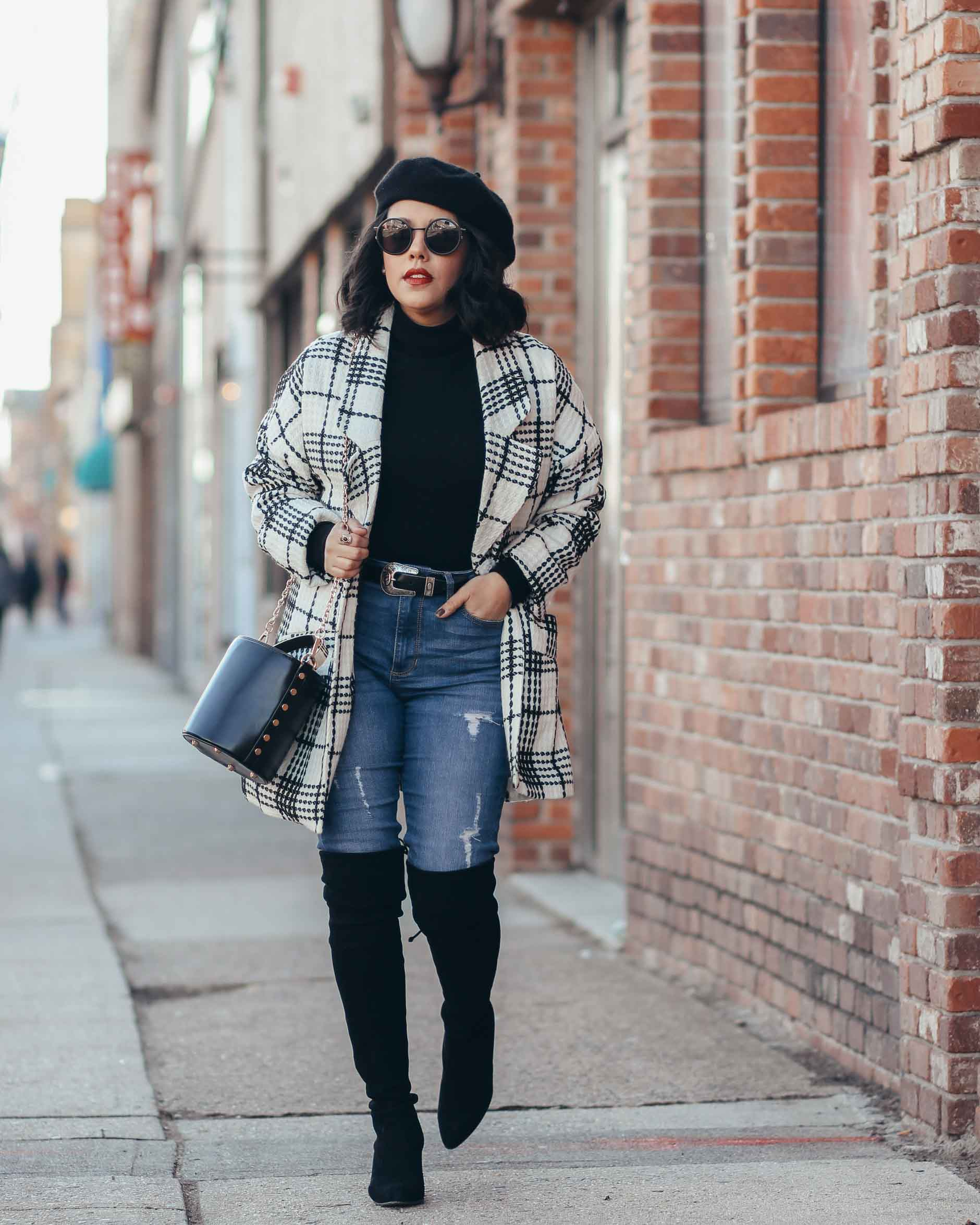 lifestyle blogger naty michele walking in denim with otk boots and a beret