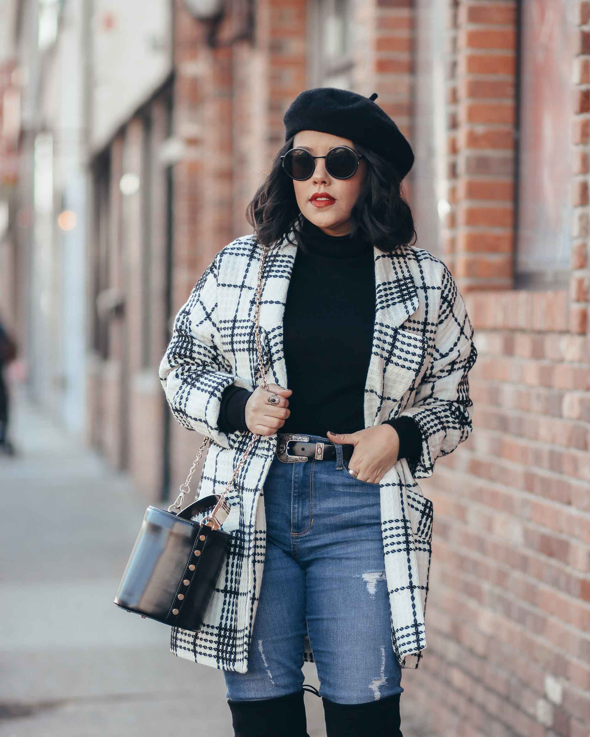 lifestyle blogger naty michele wearing a beret and a black and white coat