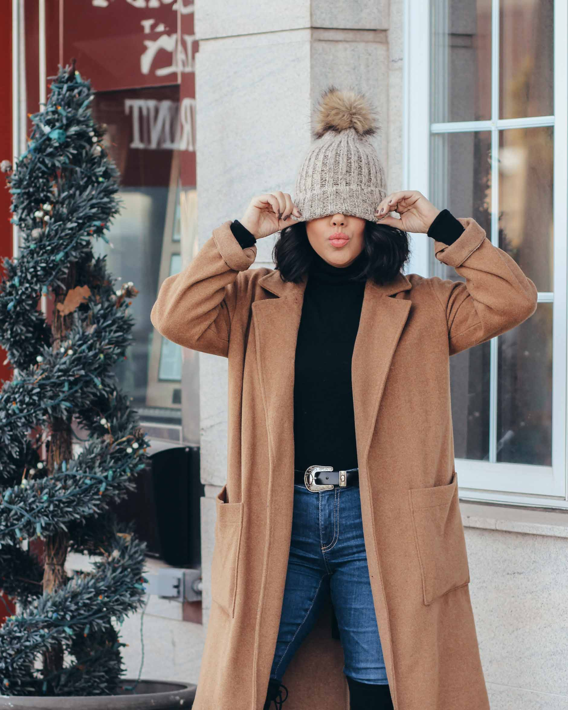 lifestyle blogger naty michele wearing pom beanie with camel coat