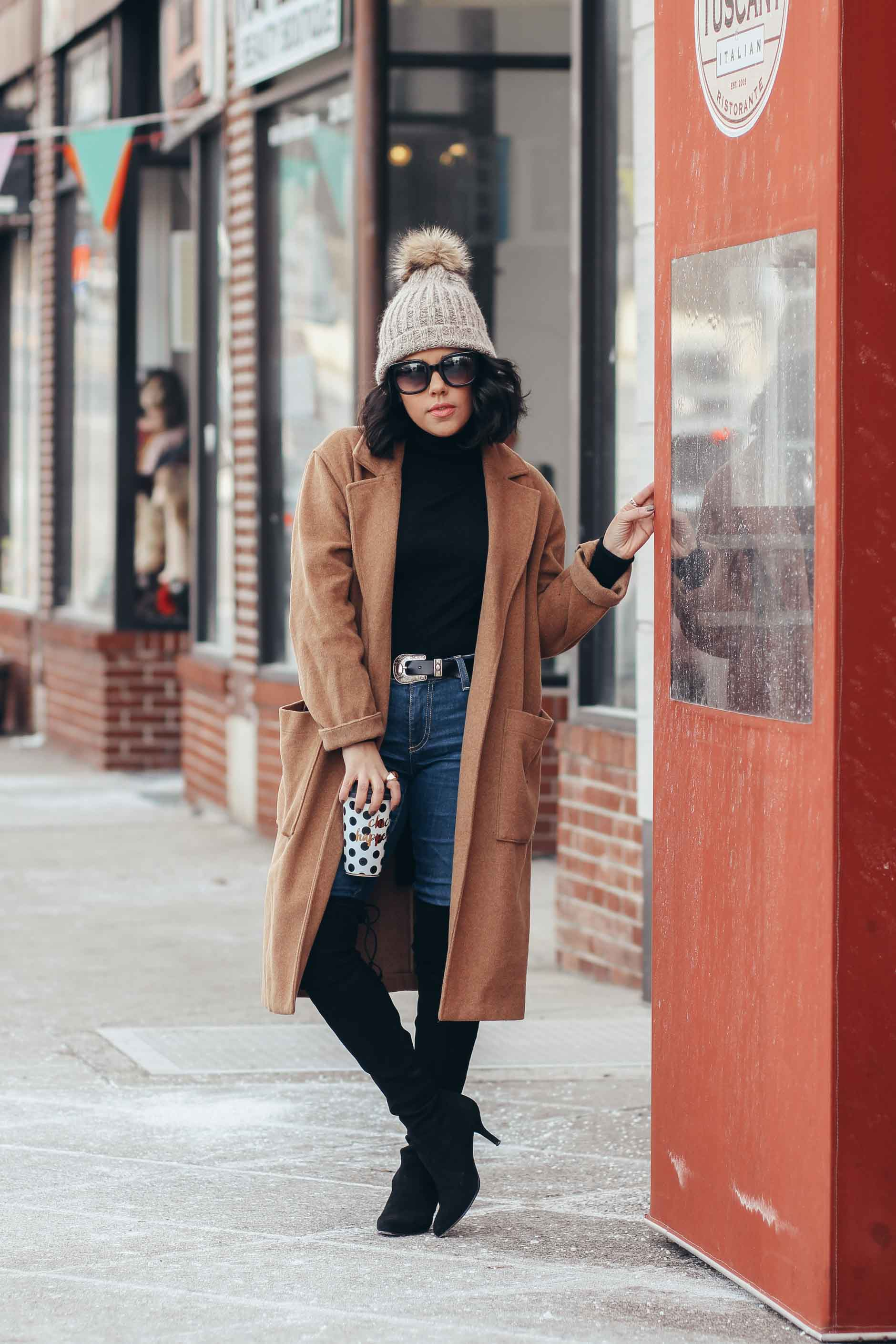 lifestyle blogger naty michele wearing a camel coat and pom beanie
