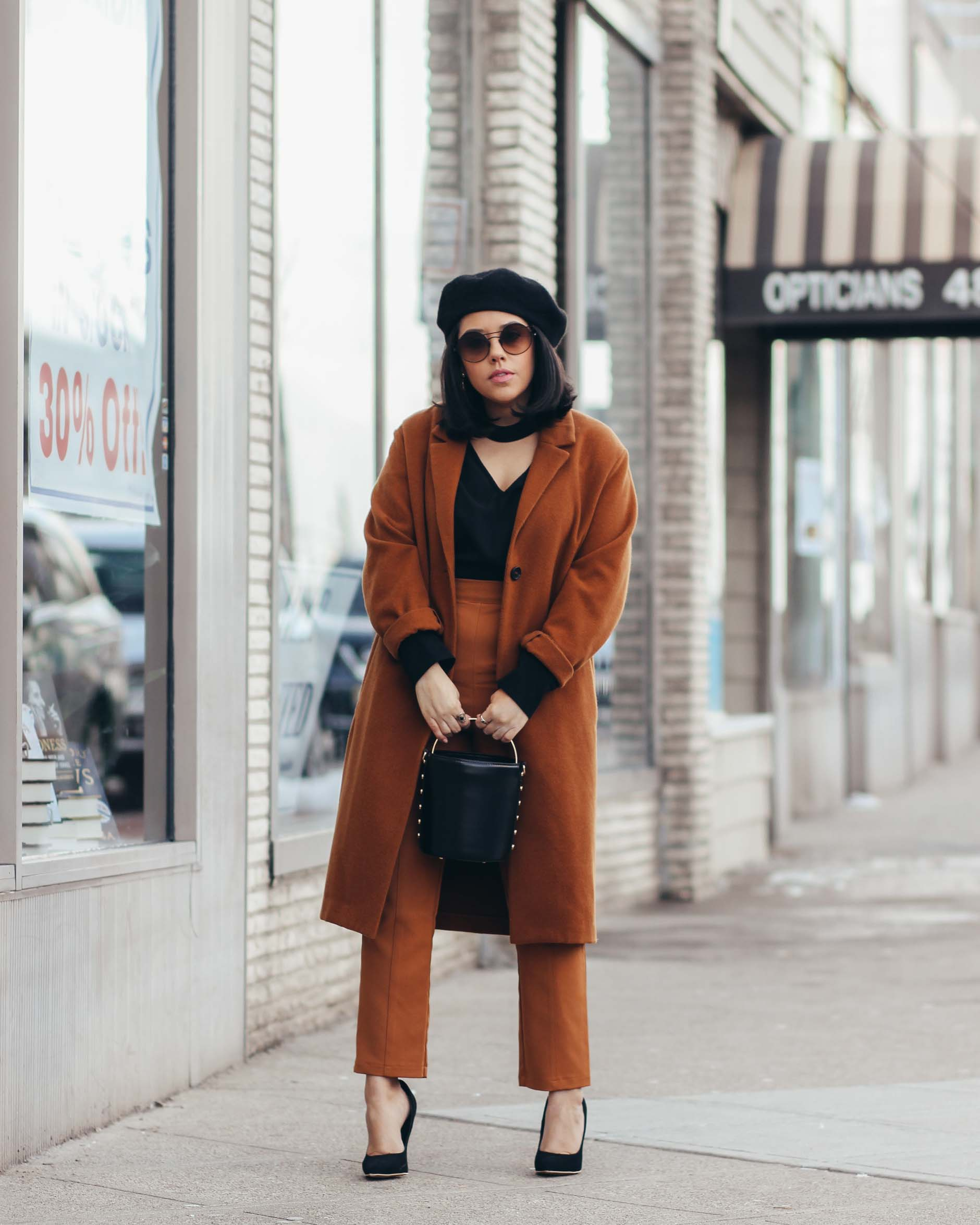 lifestyle blogger naty michele wearing a camel and black outfit