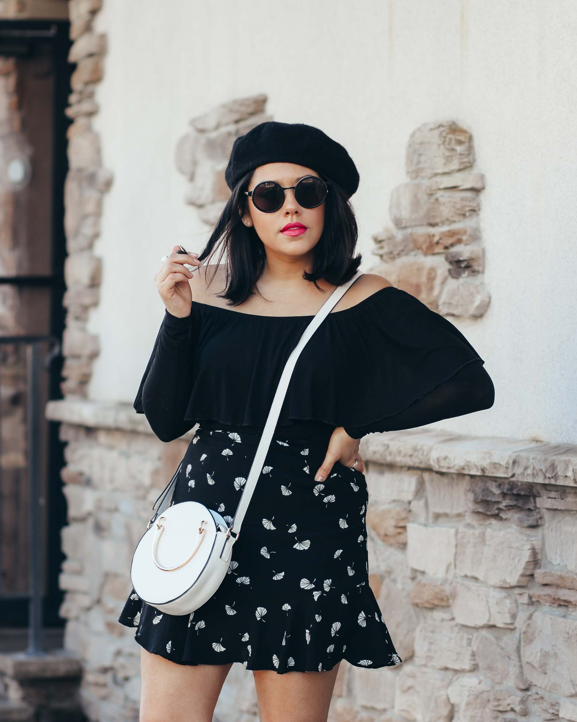 naty michele wearing a beret and off the shoulder top
