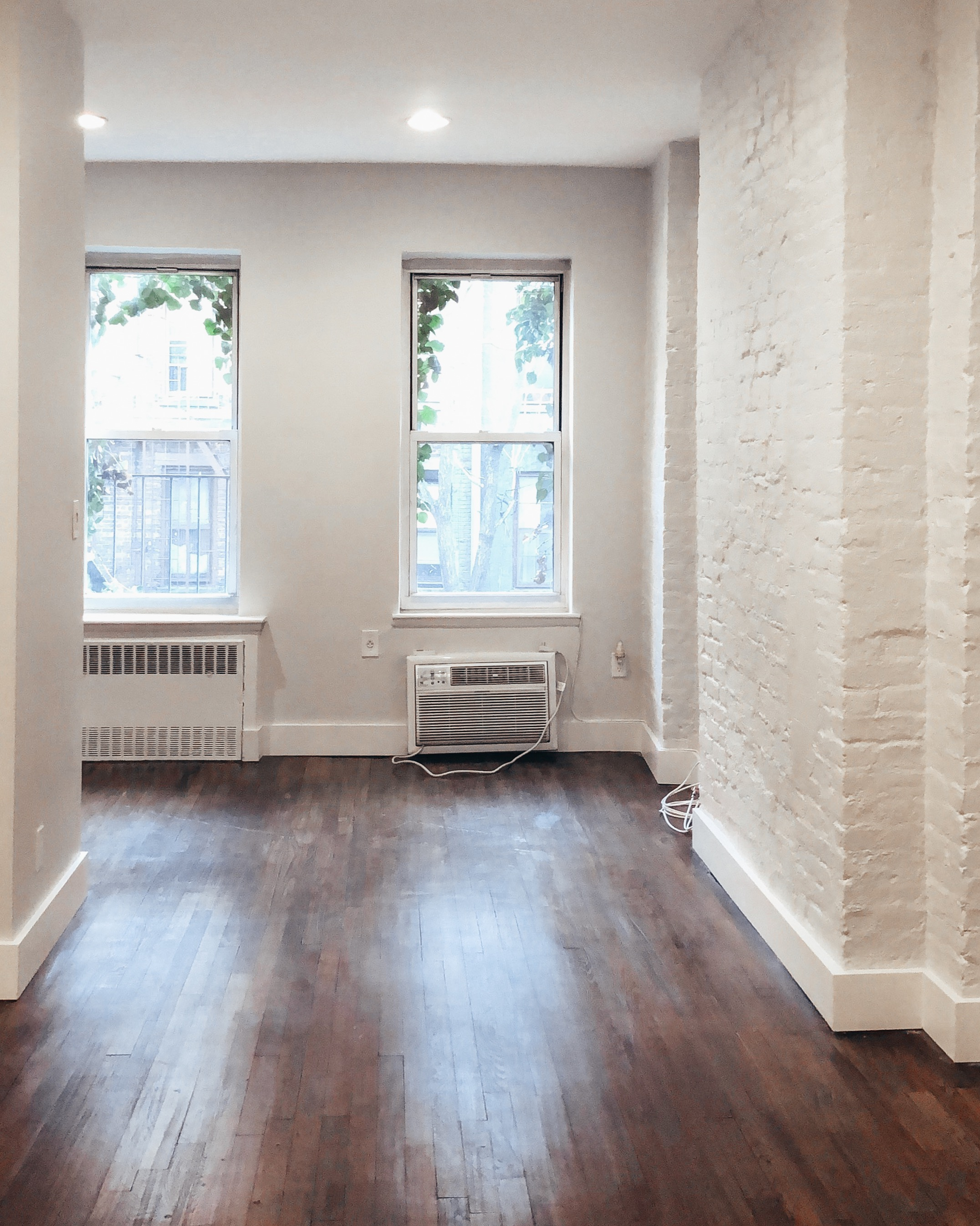 white exposed brick nyc studio apartment