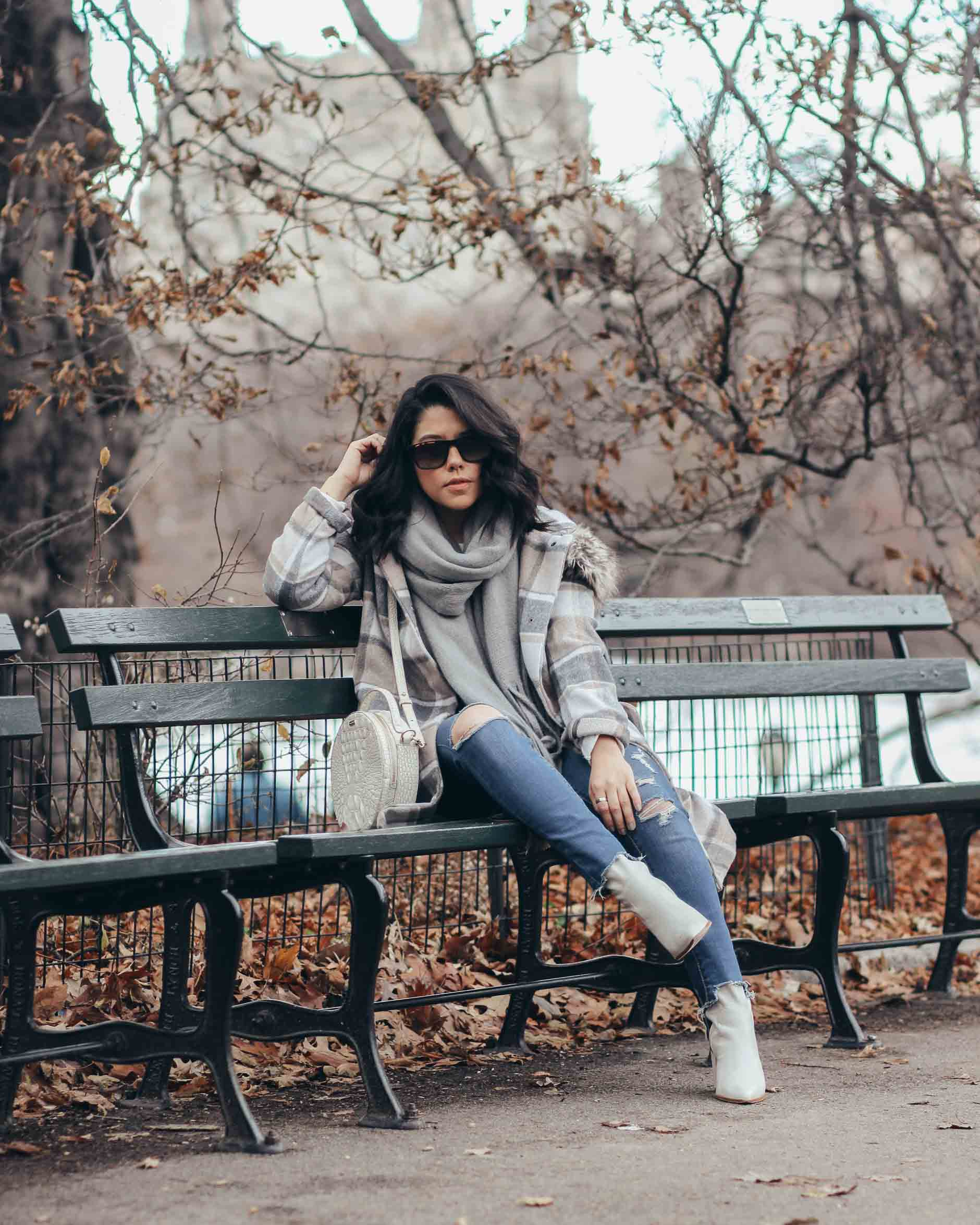 lifestyle blogger naty michele wearing stitch fix plaid coat sitting at central park