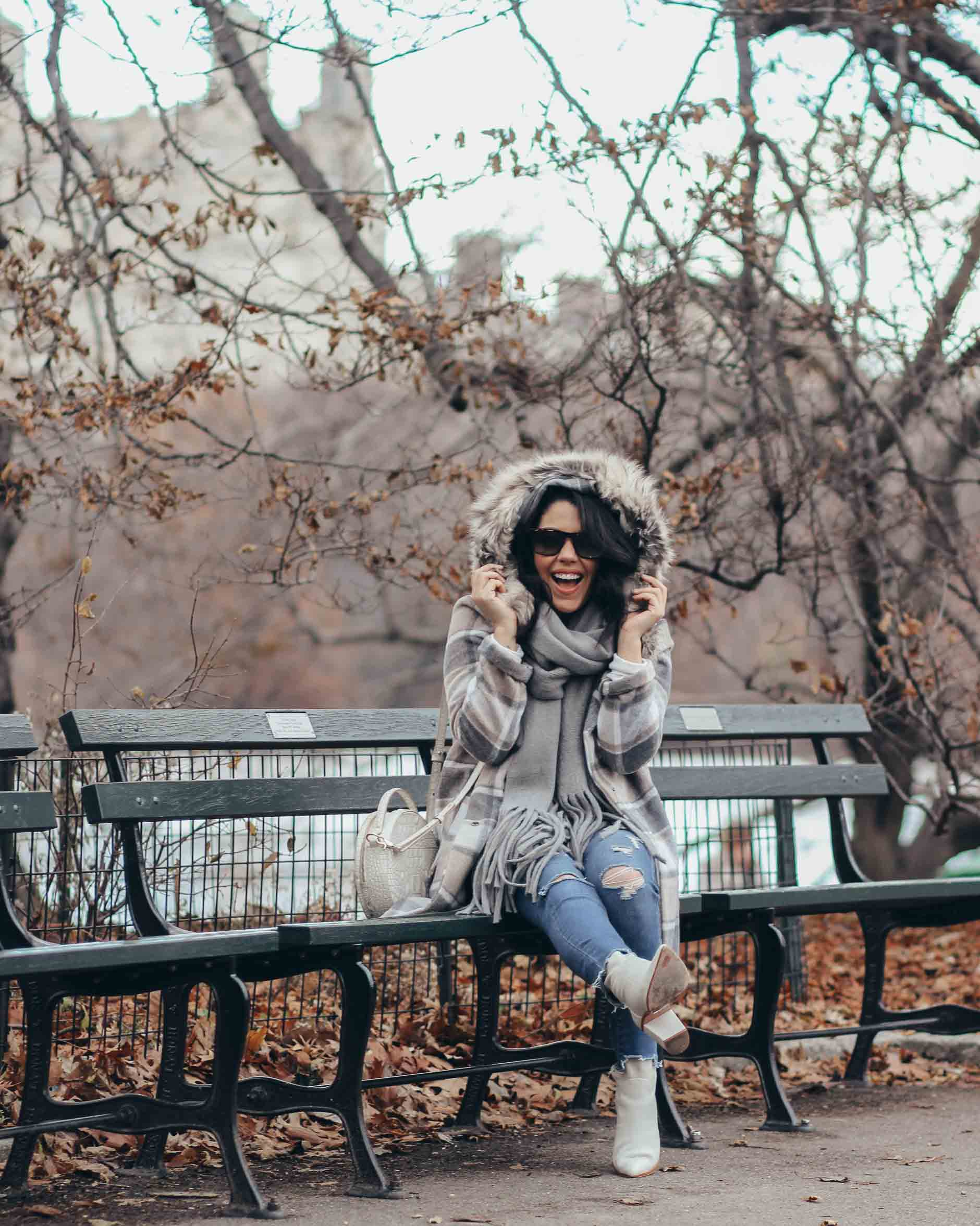 lifestyle blogger naty michele wearing plaid coat with faux fur trim hood