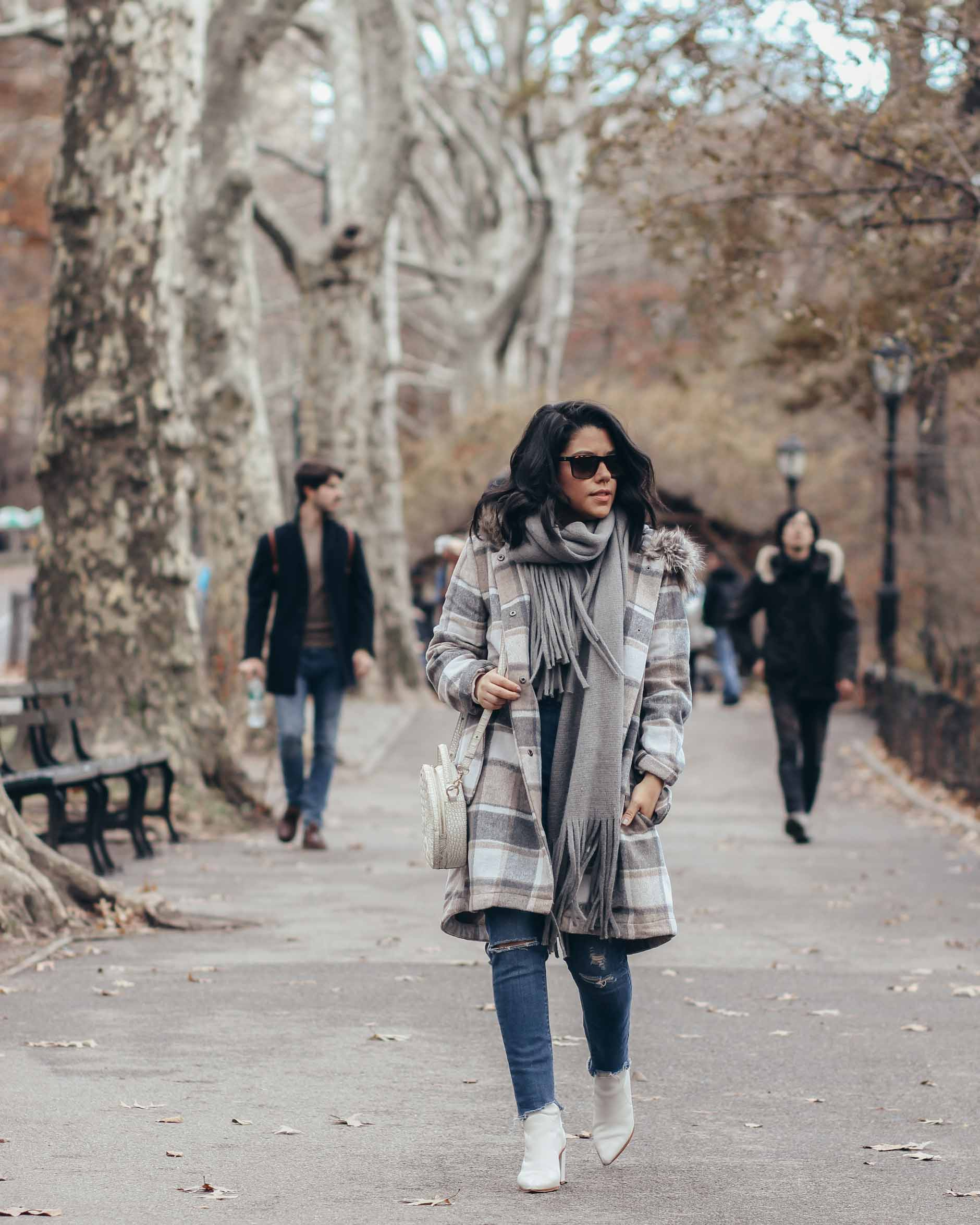 lifesyle blogger naty michele walking in central park with plaid coat